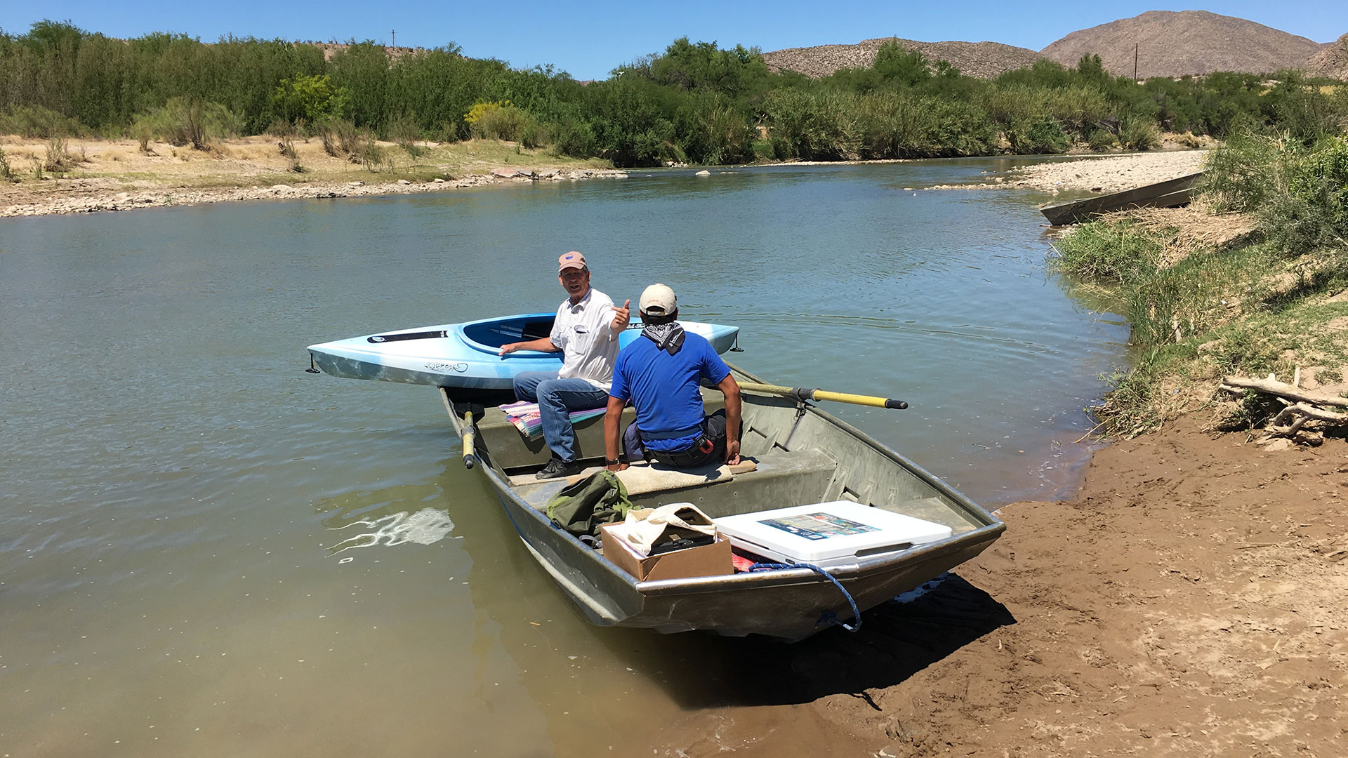 Mike Davidson, at fore of boat, holds the concession permit in the United States to operate the rowboats that ferry people back and forth across the Rio Grande between Boquillas del Carmen, Coahuila and Big Bend National Park.