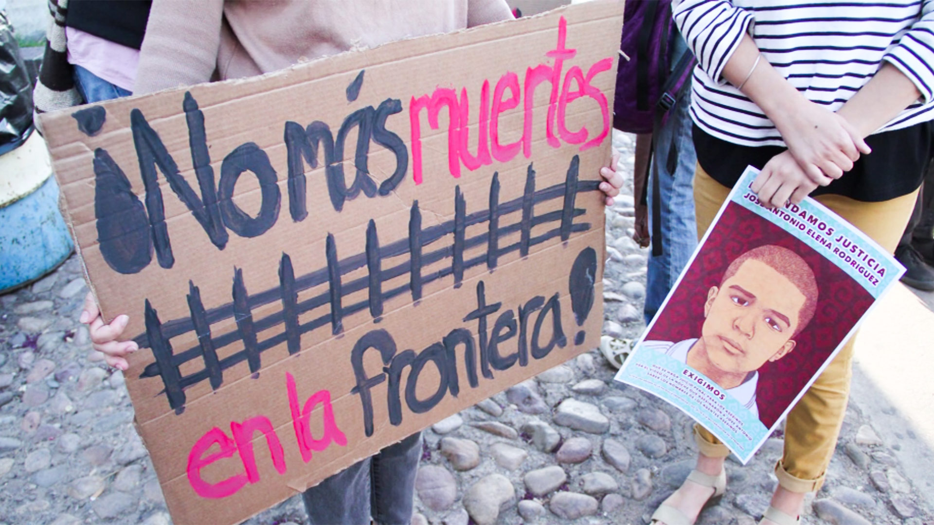 Signs held at an April 2013 protest over the death of Jose Antonio Elena Rodriguez.