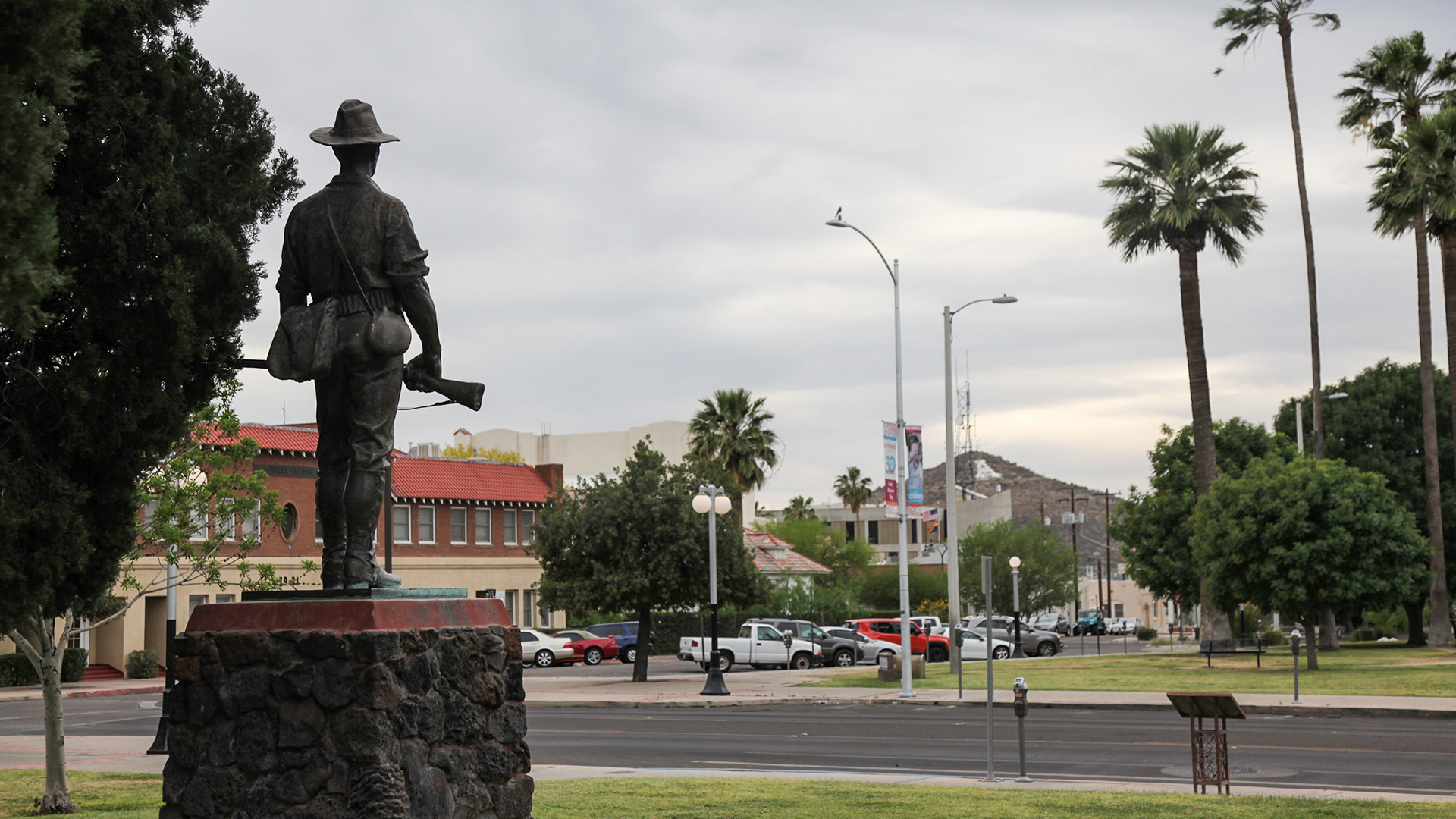 A statue in Tucson's Armory Park looks toward Sentinel Peak.