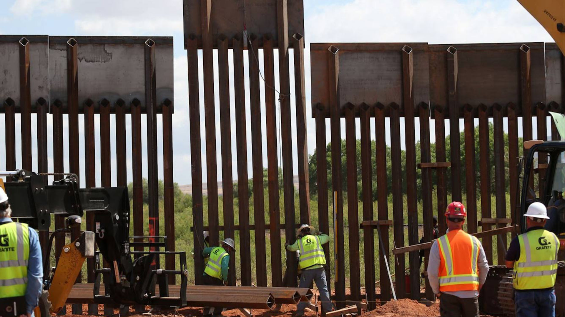 Workers install the final panel in an upgrade of 7.5 miles of border fence near Naco, May 9, 2017.
