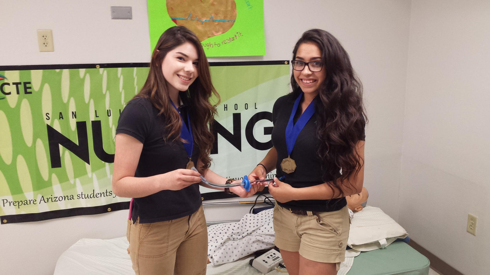 Kathy Angulo, left, and Alma Vizcarra hold their improved gastrostomy tube prototype
