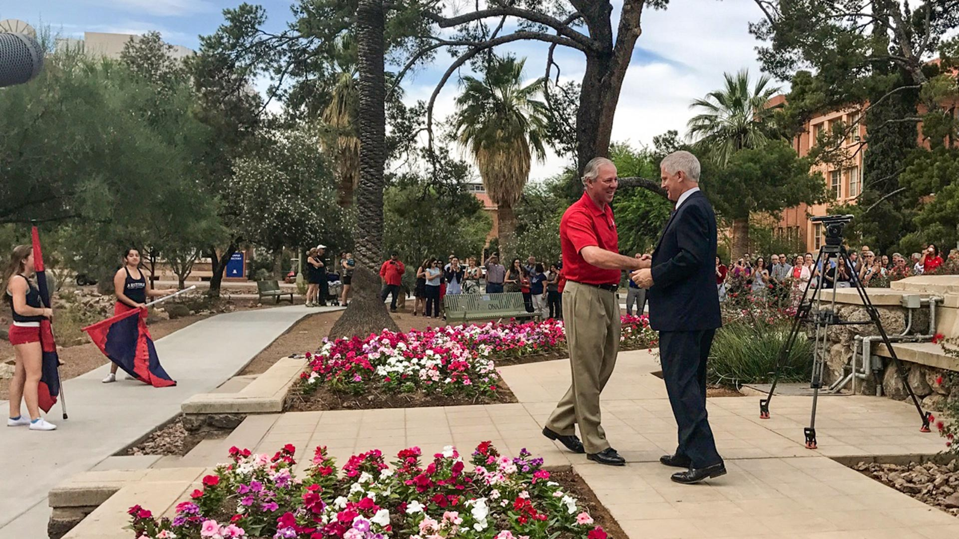 University of Arizona Provost Andrew Comrie, right, greets Robert C. Robbins on Robbins' first day as UA president, June 1, 2017.