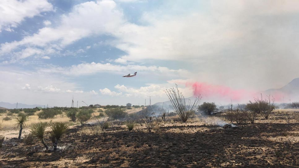 Plane drops retardant on the Lizard Fire, burning near Cochise Stronghold in Southeastern Arizona June 9, 2017.