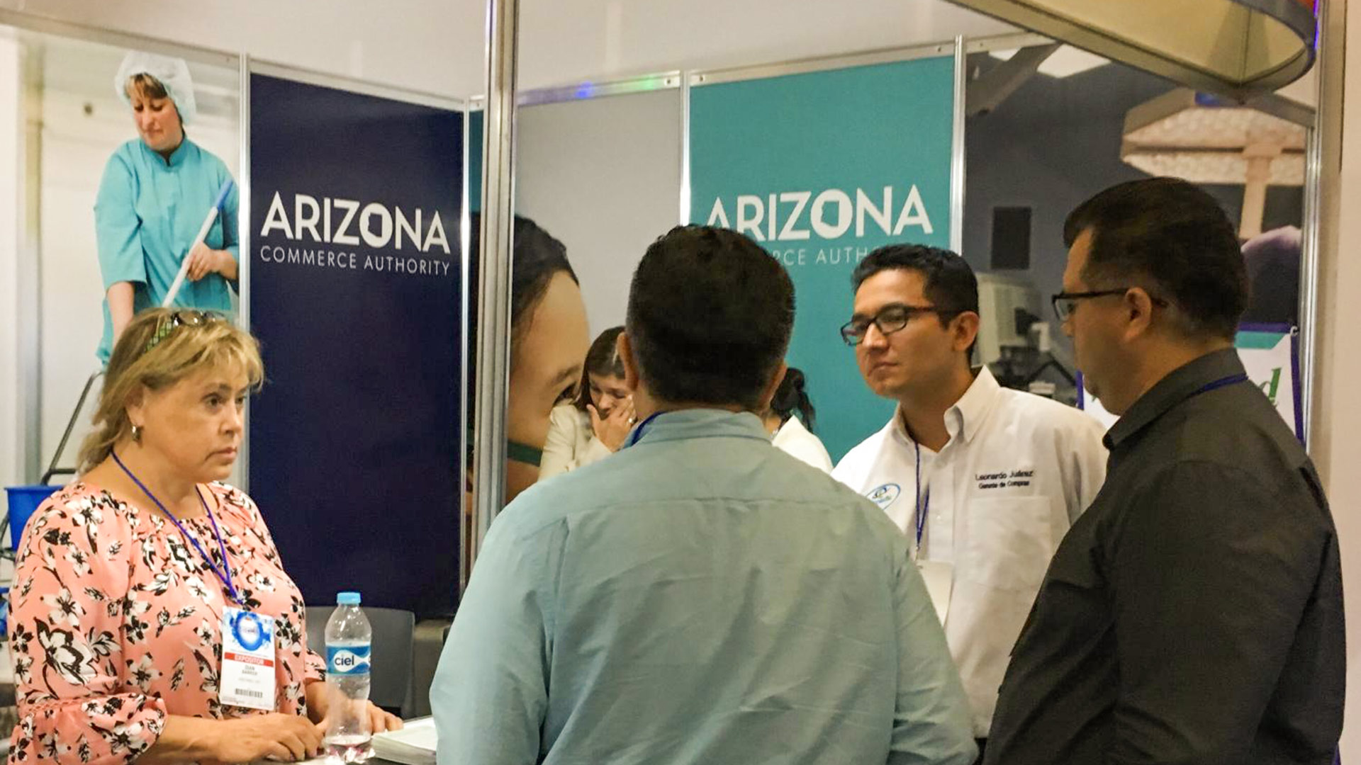 Diane Barker, left, of the Tucson-based medical manufacturer WestMed speaking with a representative from a distribution company and prospective clients at the ExpoMed medical device fair in Mexico City.