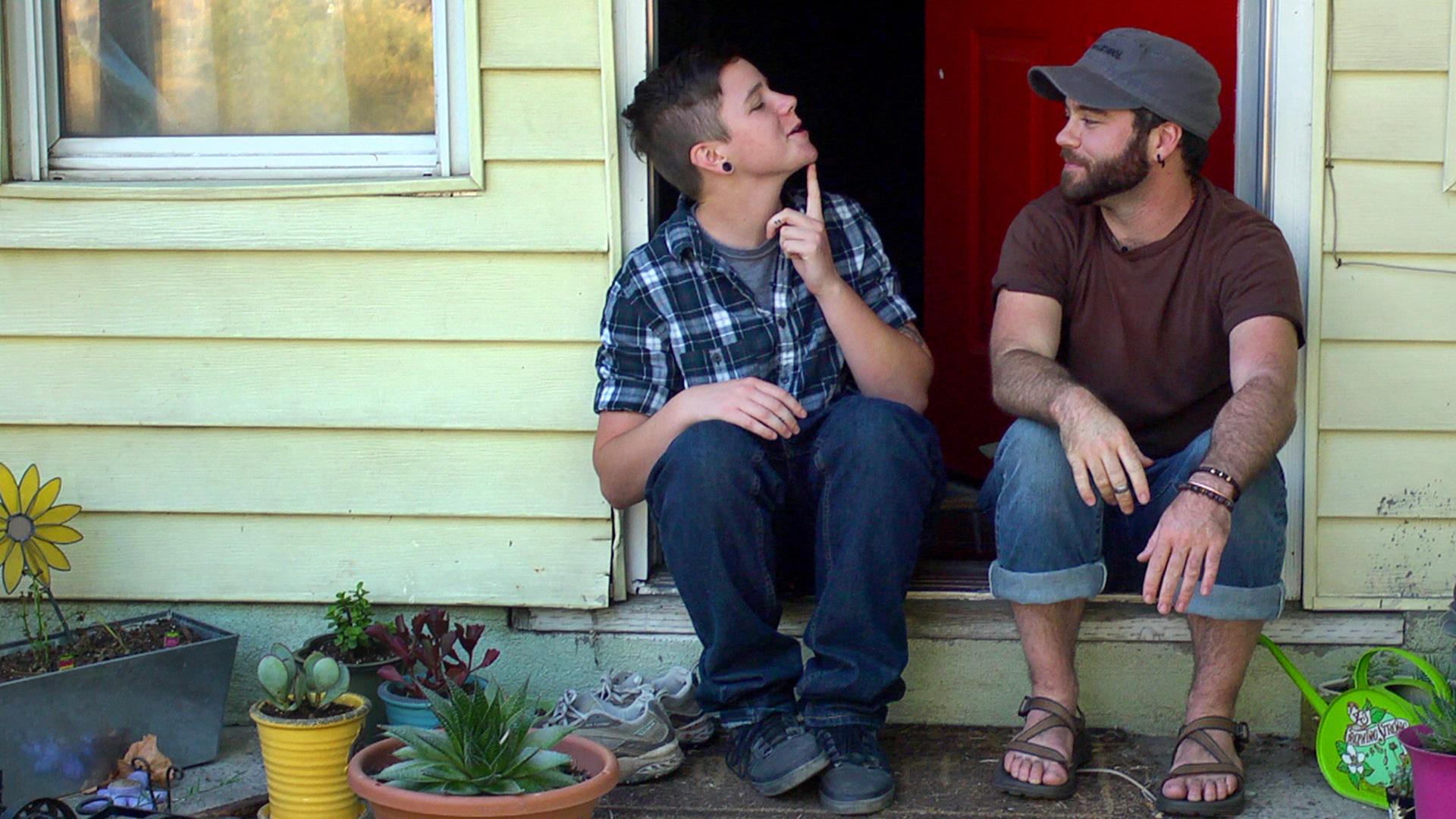 Trans teen Bennett shows his first chin hair to his friend and mentor, Joe Stevens.