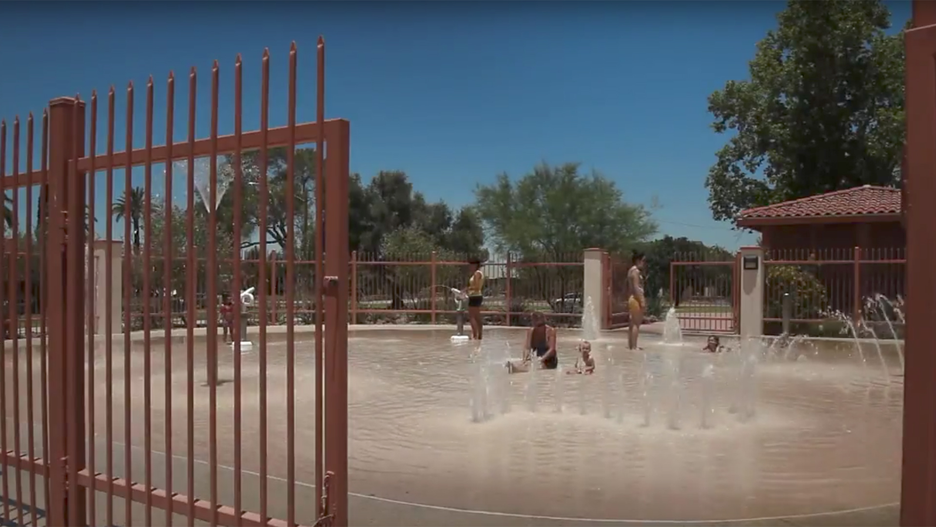 Children playing at a neighborhood splash pad.