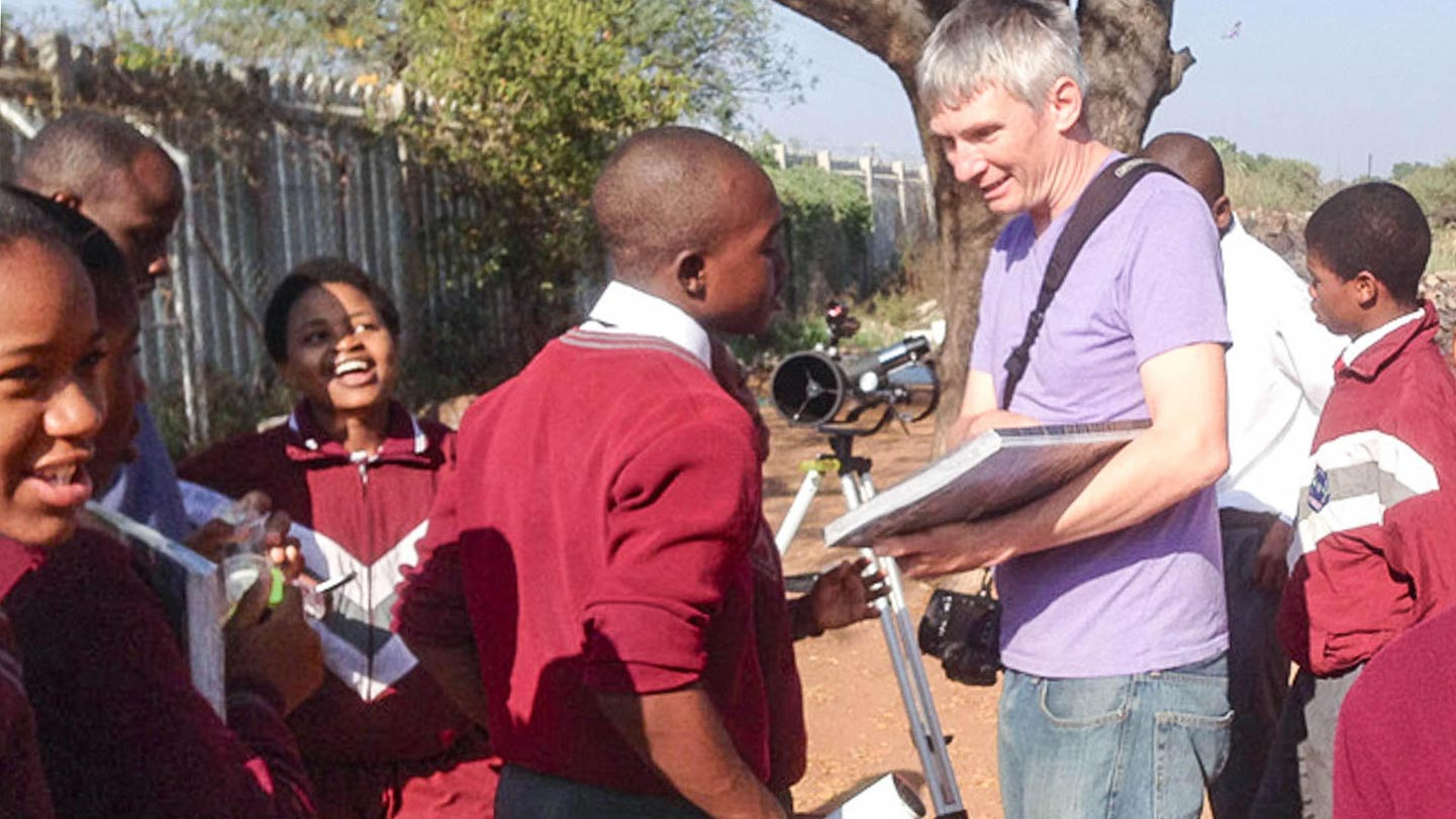 Henry Throop shows students how to use a telescope to observe sunspots during the day, at Dendron Secondary school in rural Limpopo, South Africa.