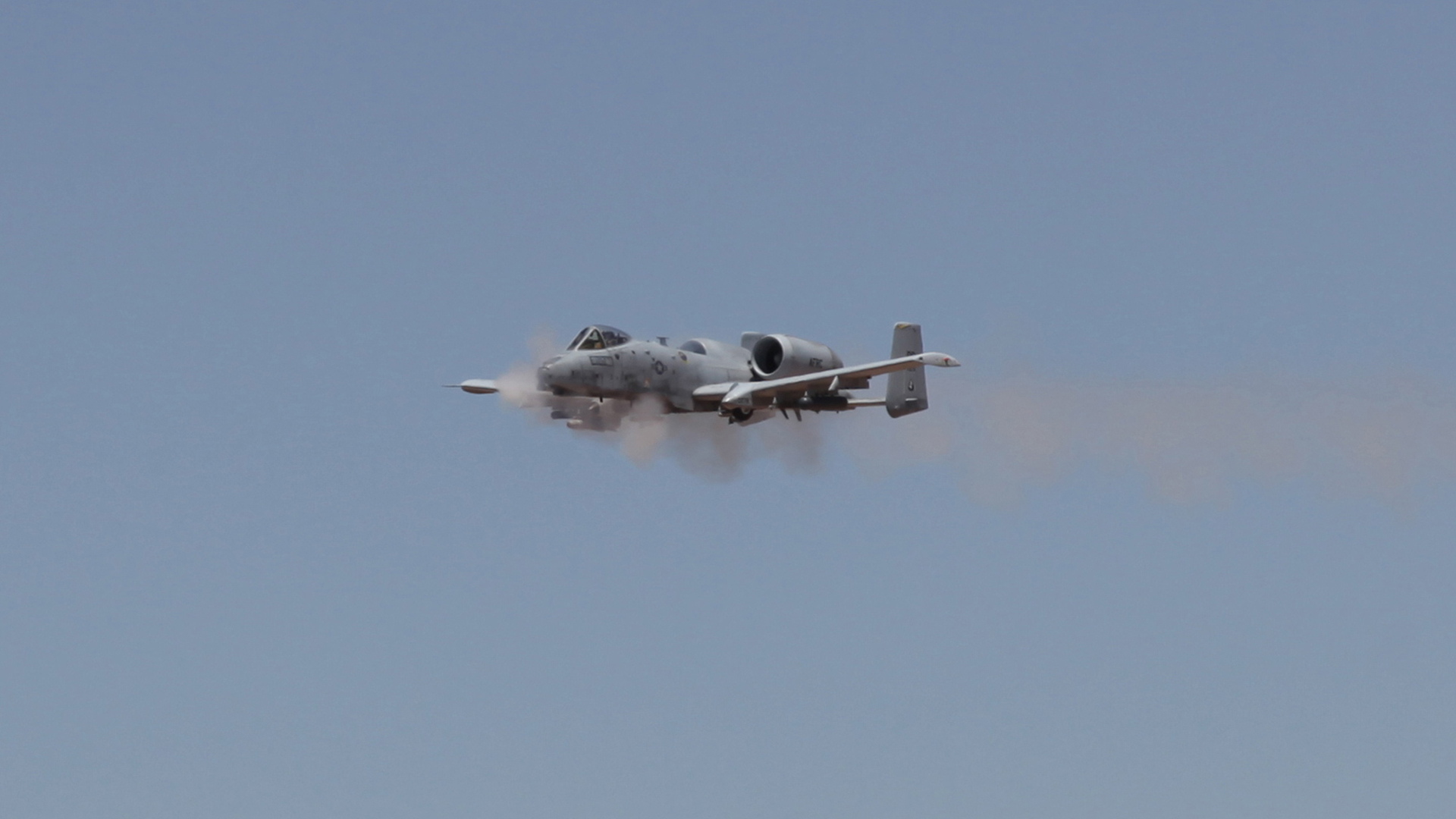 An A-10 from Davis-Monthan Air Force Base fires its gun at the Goldwater Range during the Hawgsmoke competiton.  June 2016