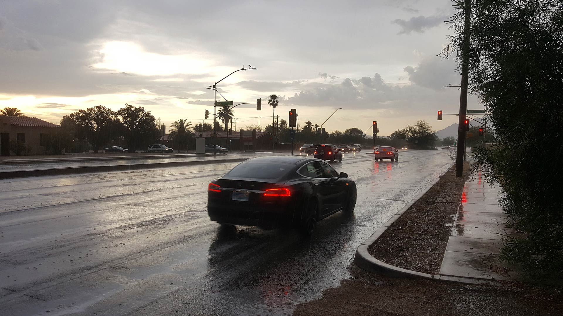 Cars drive down Campbell Avenue during a brief monsoon storm. From July 2017.
