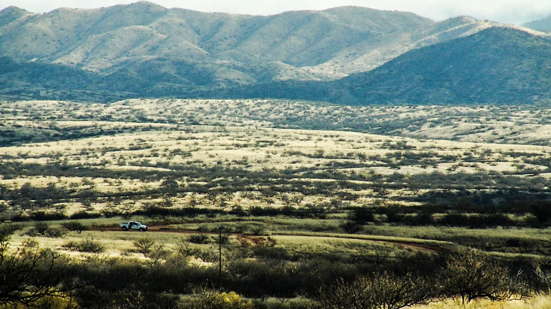 A U.S. Border Patrol vehicle in the desert.