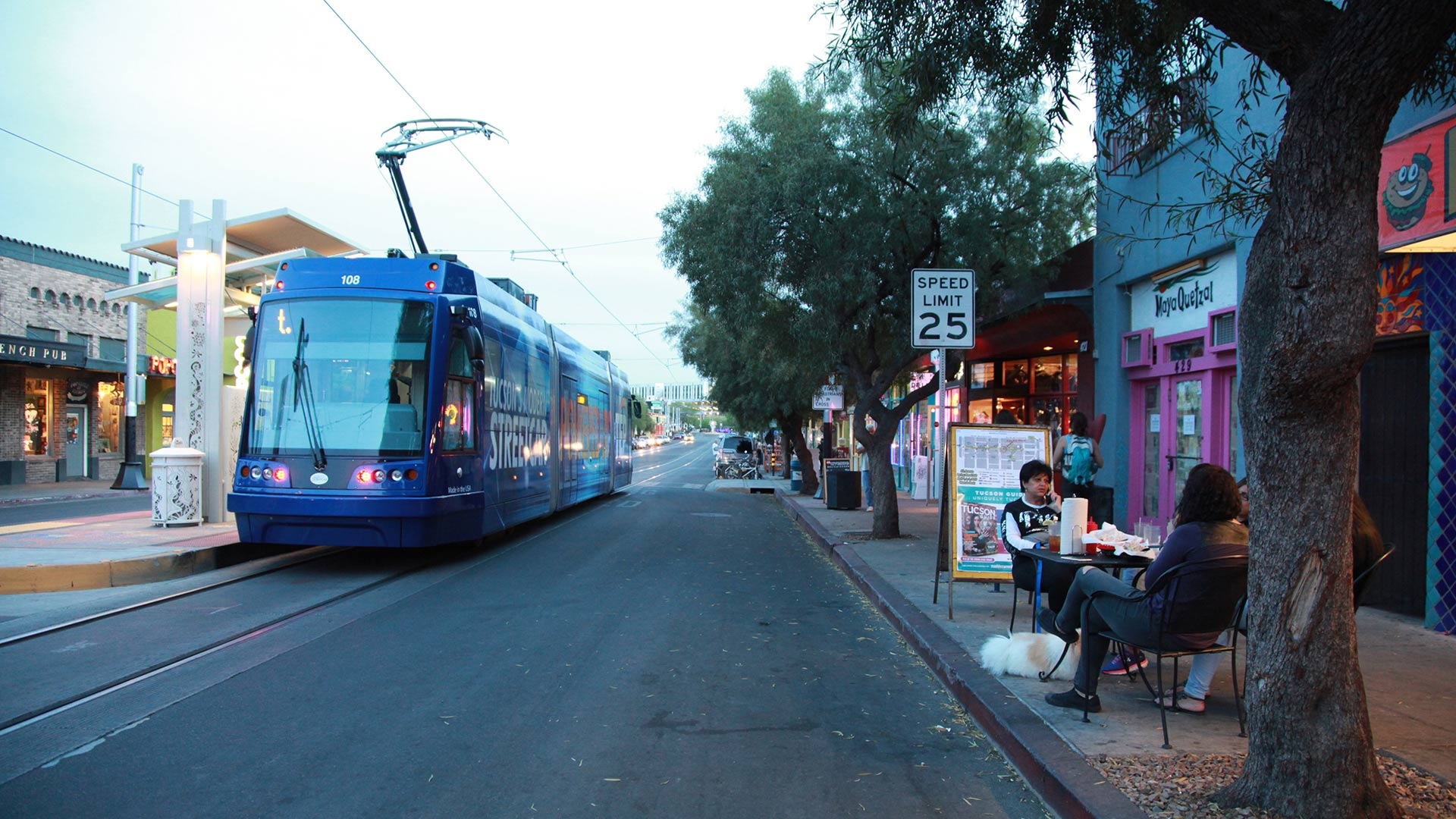 The streetcar passes people eating dinner on 4th Avenue on April 5, 2015.