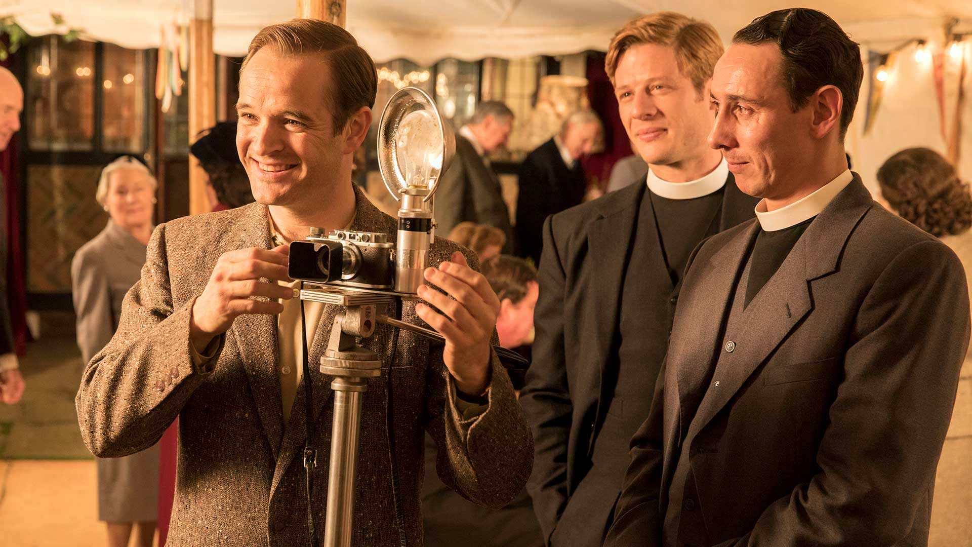 Pictured from left to right: Oliver Dimsdale as Daniel Marlowe, James Norton as Sidney Chambers, and Al Weaver as Leonard