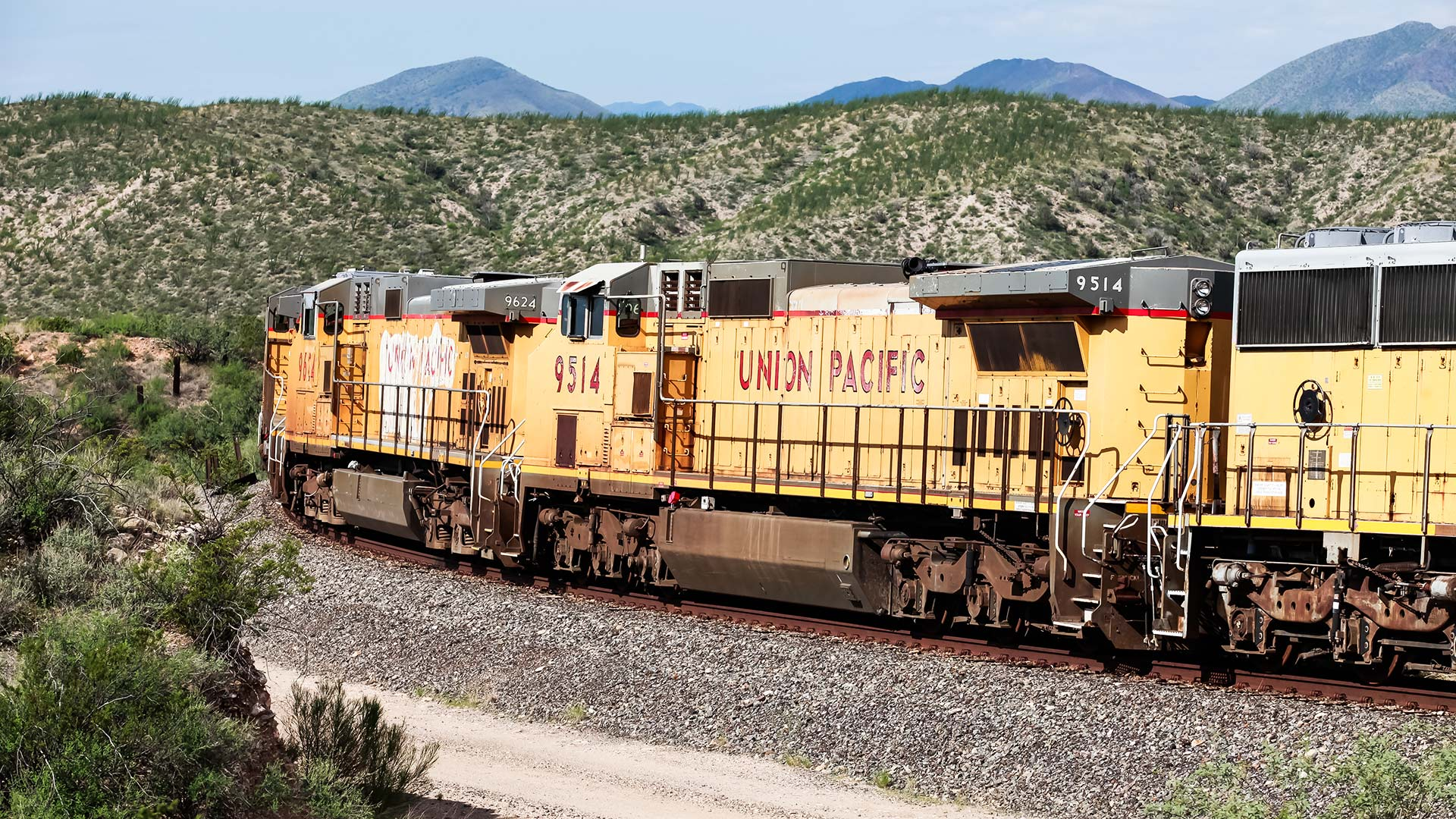 A Union Pacific train passes.
