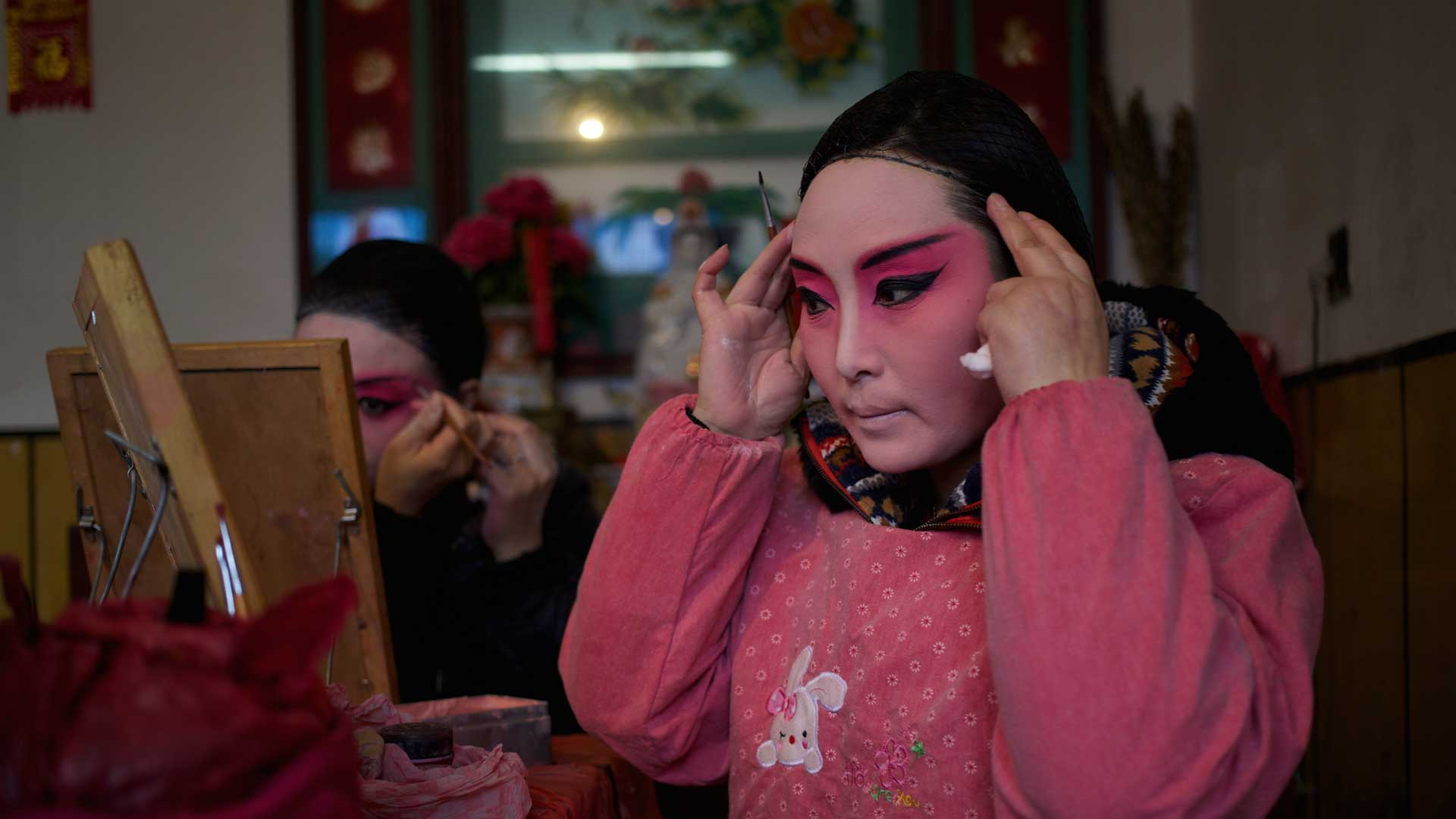 Actors preparing for an open-air theatrical performance in the village of Dinggou, Yangzhou