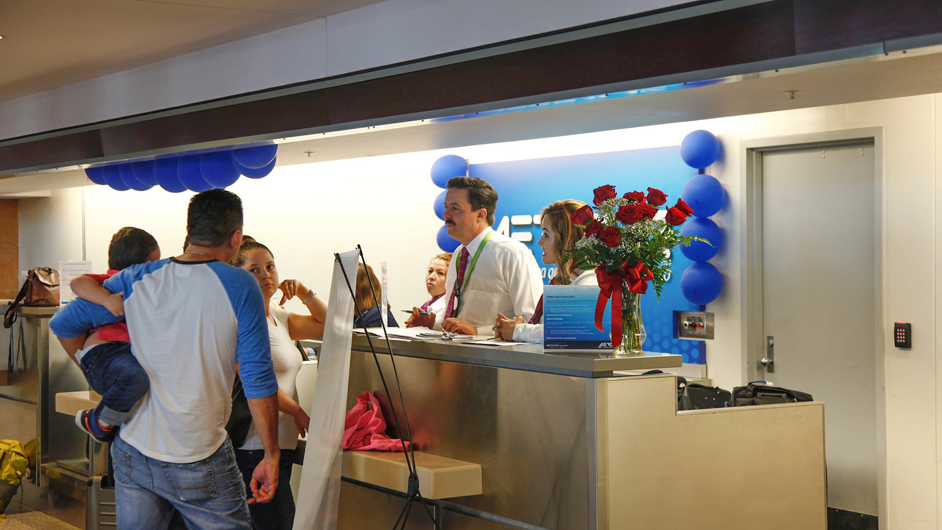 Customers check in at the ticket counter on the first day of Aeromar's 10-month service to and from Tucson.