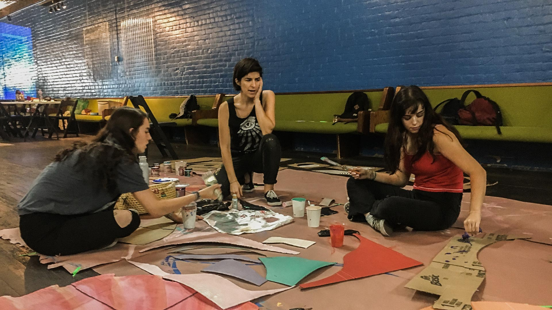 Lano Dash assembles an art installation with her little sister, Sophia, and her friend, Renae. The piece will be featured at this year's Chick Magnet festival.