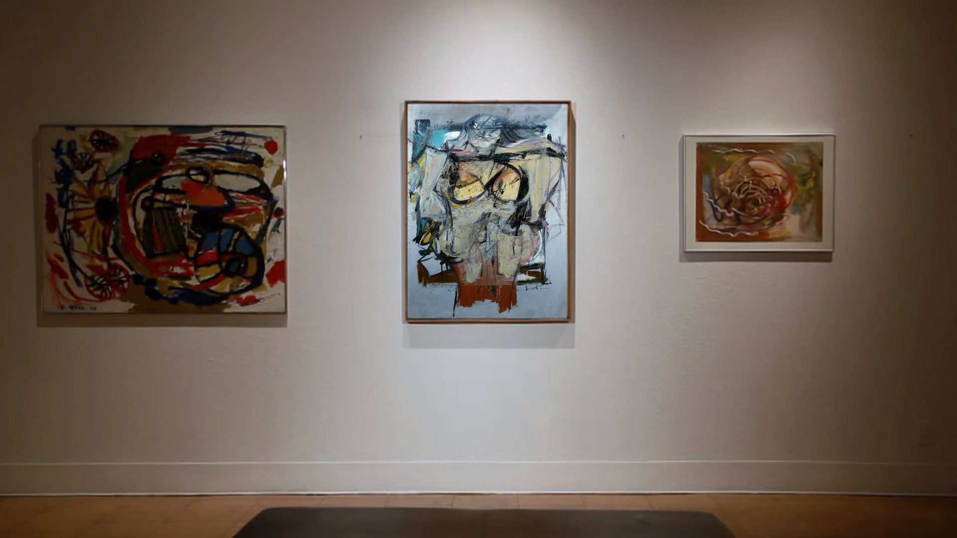 "A recreation of a gallery scene, with the Willem de Kooning painting ""Woman - Ochre"" at center."