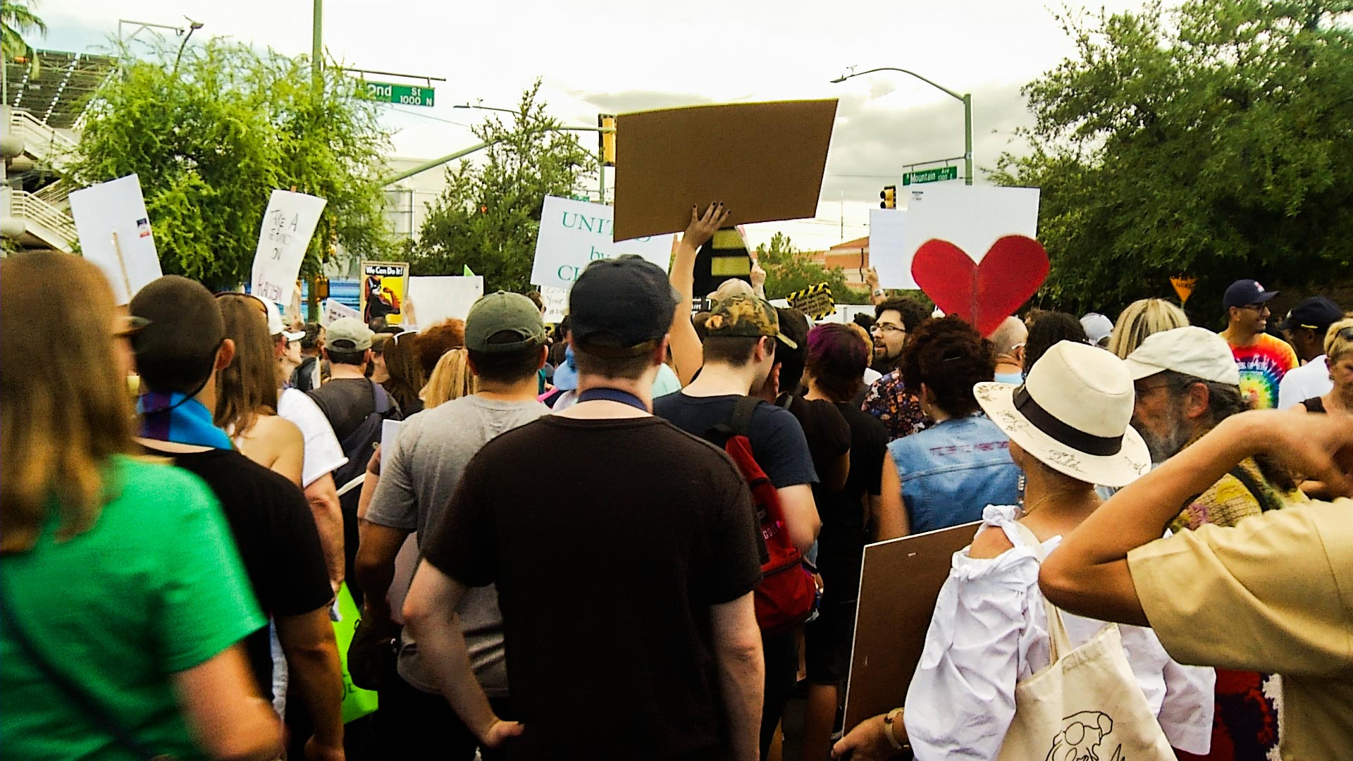 More than 2,000 people marched in Tucson Sunday in reaction to violent events at a white nationalist rally in Charlottesville, Virgina.