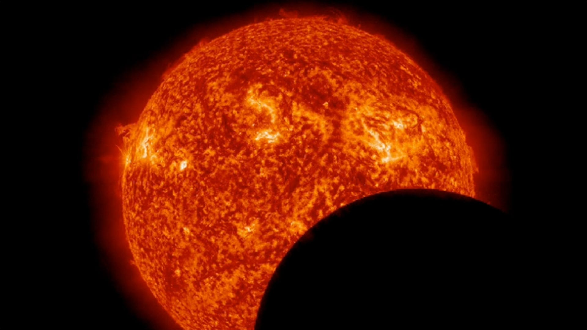 This image from NASA's Solar Dynamics Observatory on Mar. 11, 2013, at 8:00 a.m. EDT, shows the moon crossing in front of the sun.