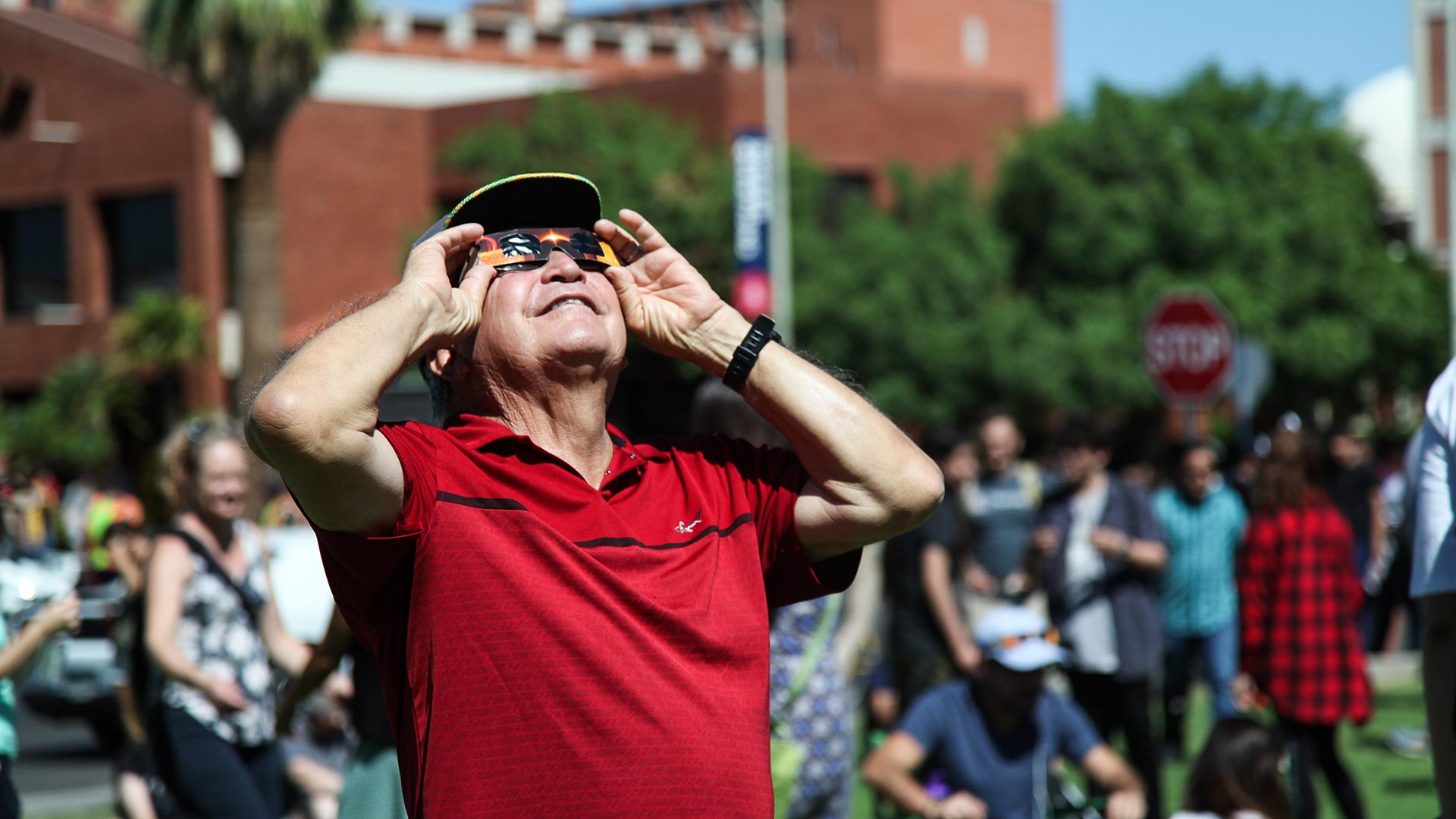 Tucsonan Rafael Guillen views the solar eclipse through glasses he purchased at the UA's Flandreau Science Center and Planetarium.