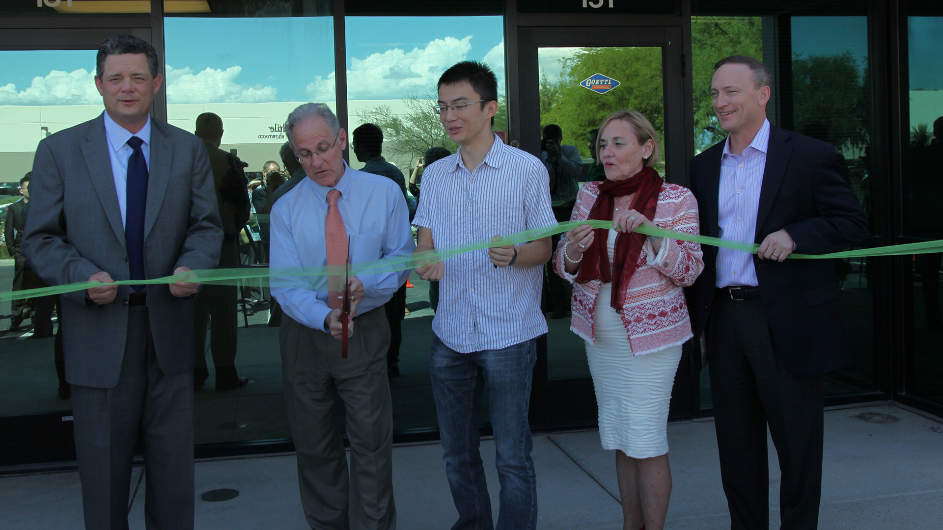 From left, Sun Corridor CEO Joe Snell, Tucson Mayor Jonathan Rothschild, TuSimple CTO Xiaodi Hou, Pima County Supervisor Sharon Bronson and Sun Corridor Board Chair and UNS Energy CEO Dave Hutchens cut the ribbon at a media event introducing TuSimple's Tucson office.
