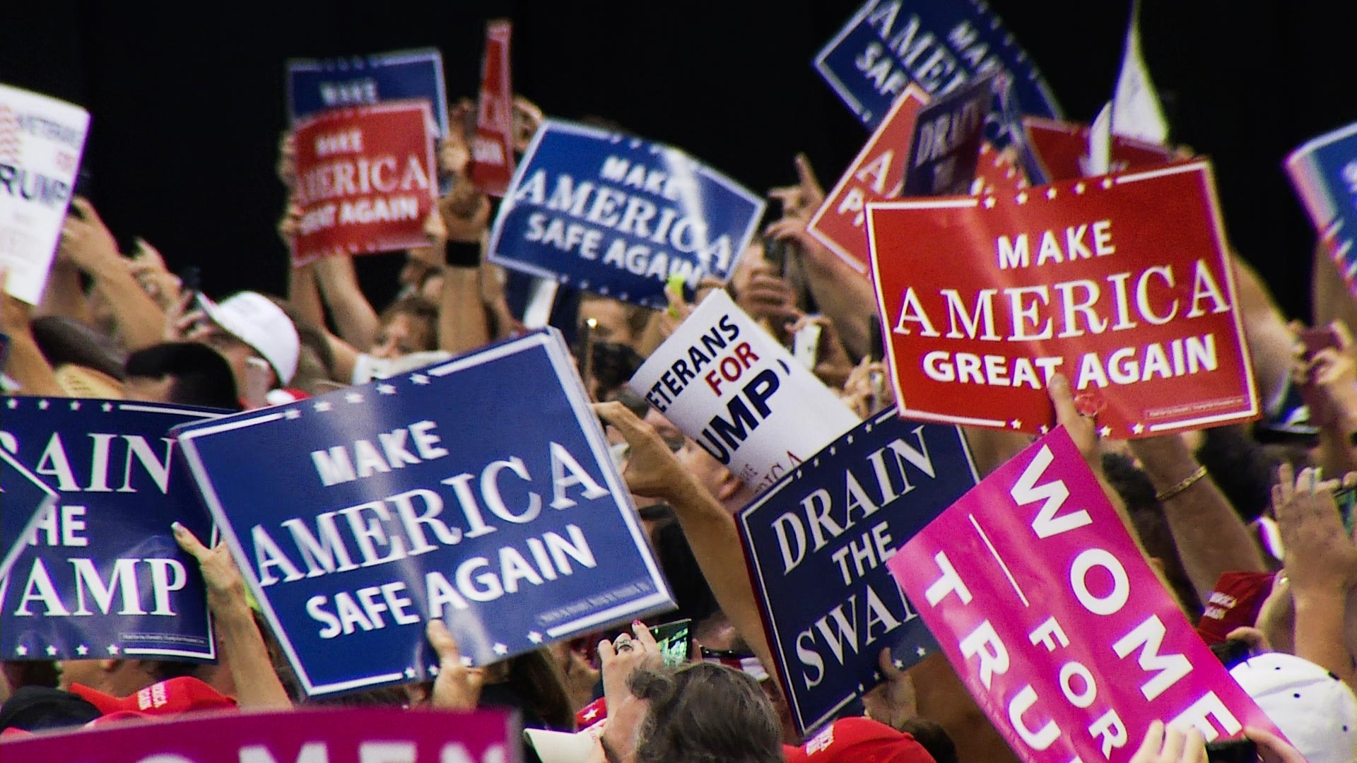 Trump supporters attend a rally in Phoenix, Aug. 22, 2017.
