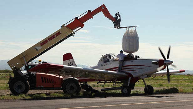 Crews load water into a plane to be dumped on the Frye Fire
