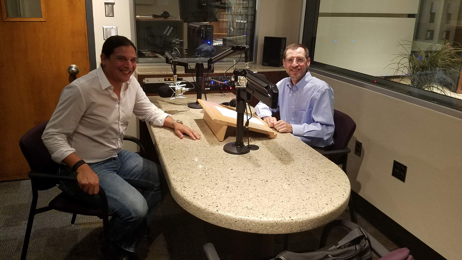 AZPM's Andy Bade (right) in the AZPM studio with Jose Luis Gomez (left) from the Tucson Symphony Orchestra.