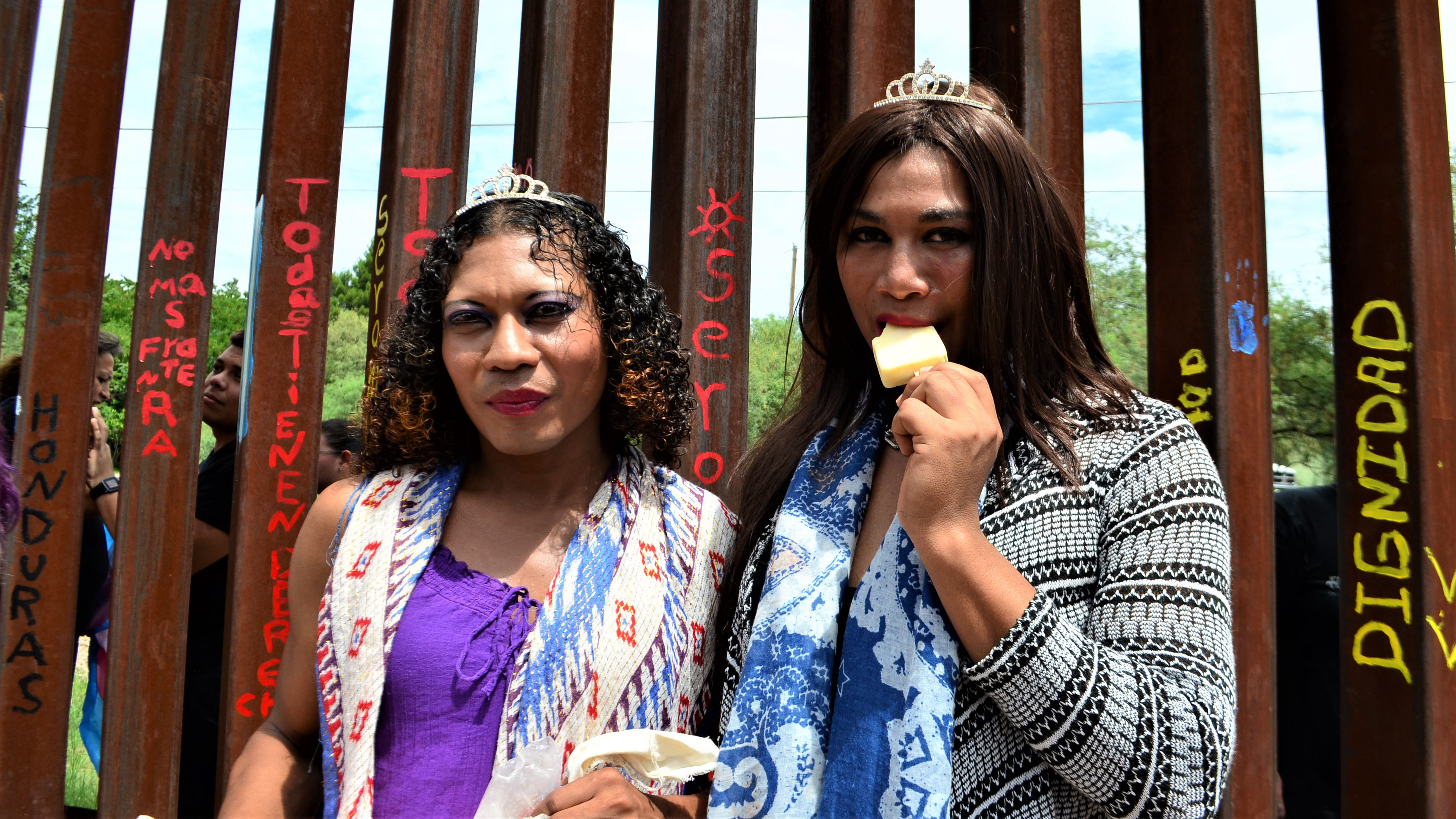 Joseling, left, and Estefany stand in front of the border fence, before walking to the DeConcini Port of Entry in Nogales, on August 10, 2017.