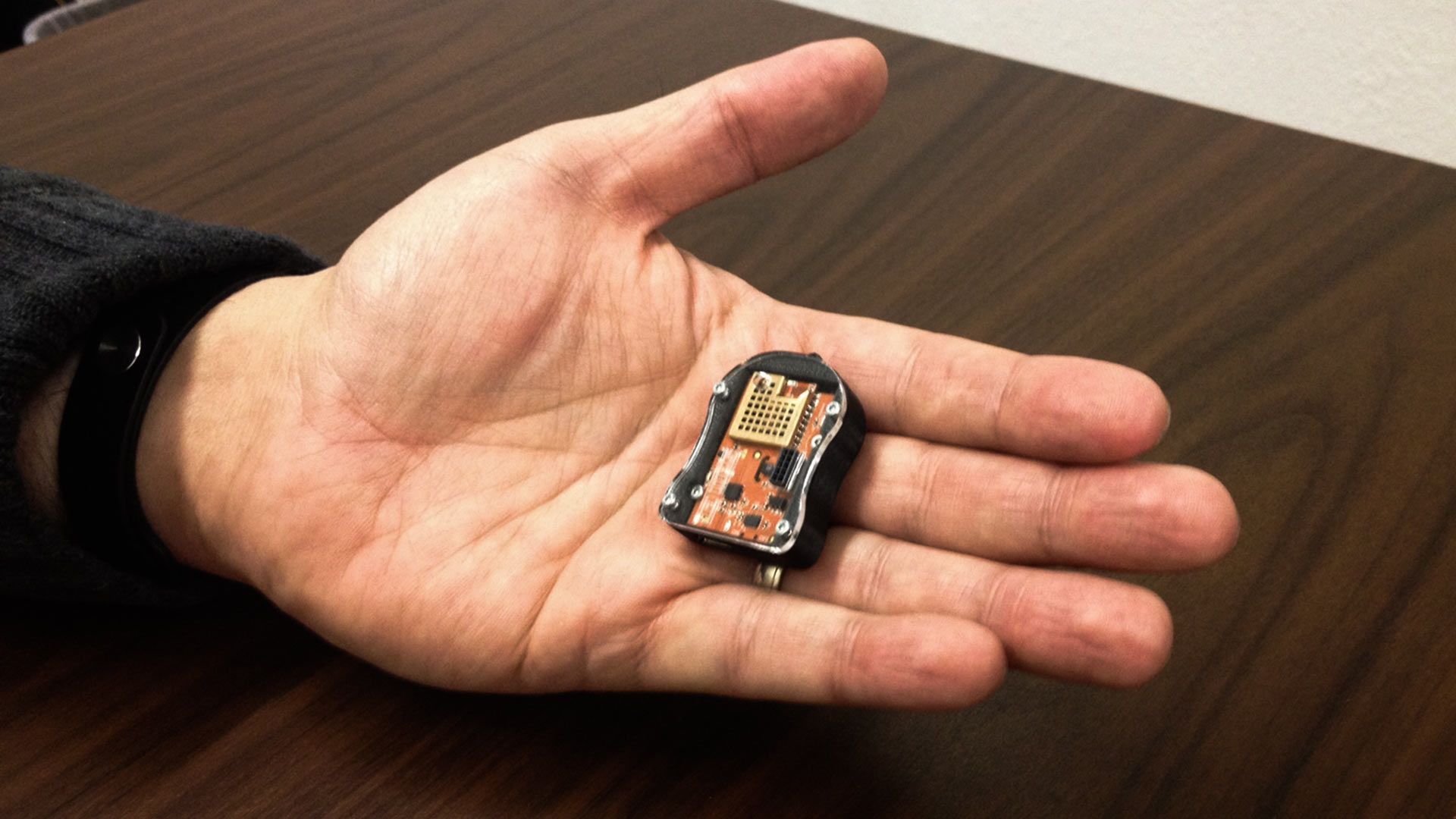University of Arizona mining engineering professor Moe Momayez holds a sensor developed to warn miners and other workers of hazardous conditions.