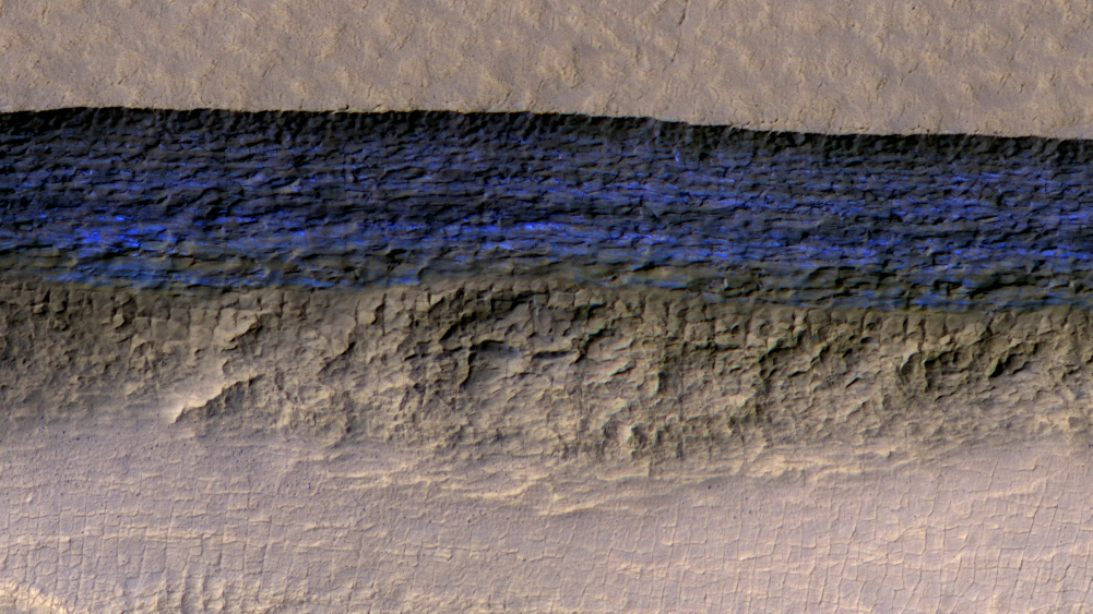 A cross-section of a thick sheet of underground ice is exposed in this enhanced-color view from the High Resolution Imaging Science Experiment (HiRISE) camera on NASA's Mars Reconnaissance Orbiter.