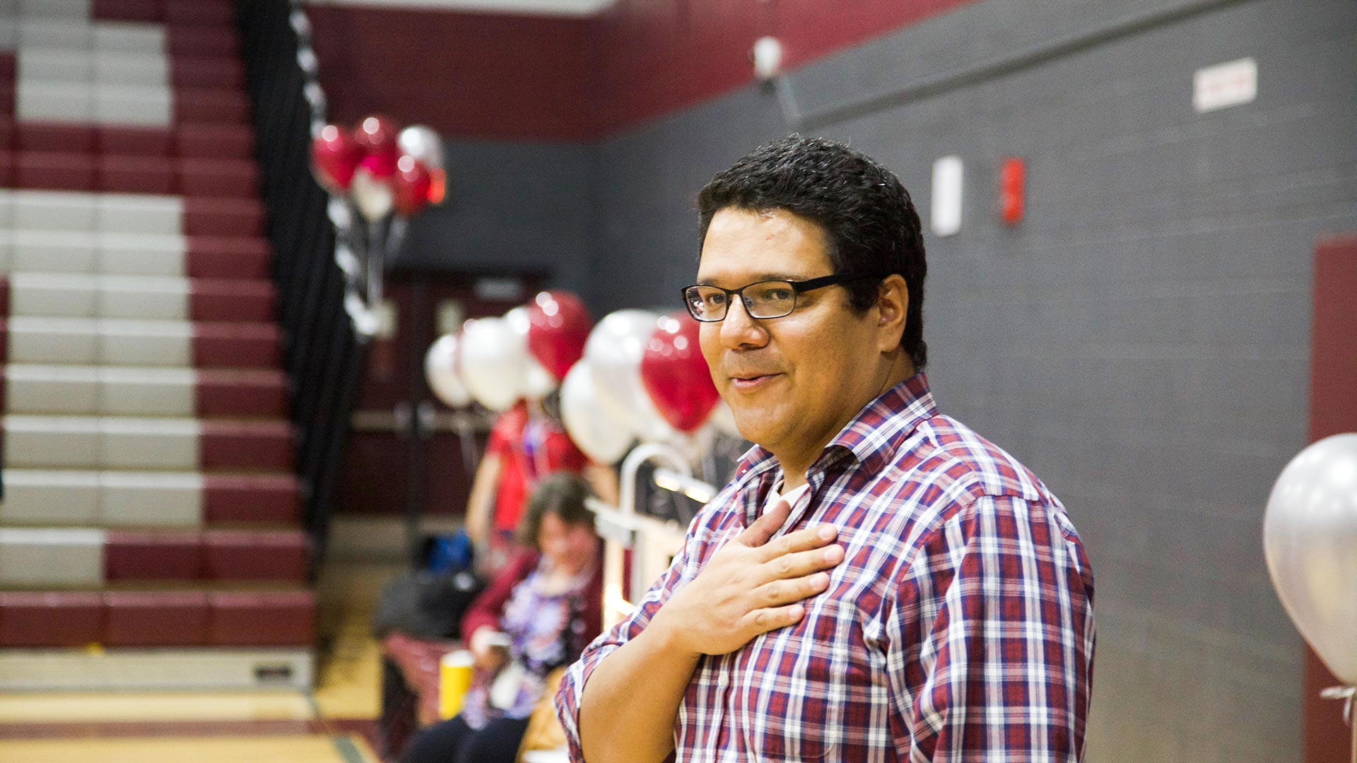 Desert View High School chemistry teacher Jonathan Cadena breathes out following the surprise announcement that he was the recipient of a Milken Educator Award.