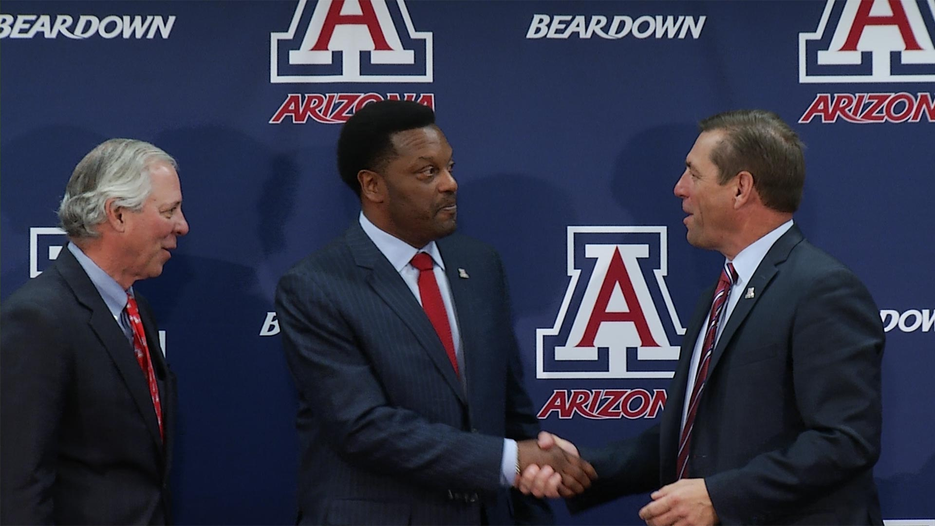 UA football coach Kevin Sumlin, center.