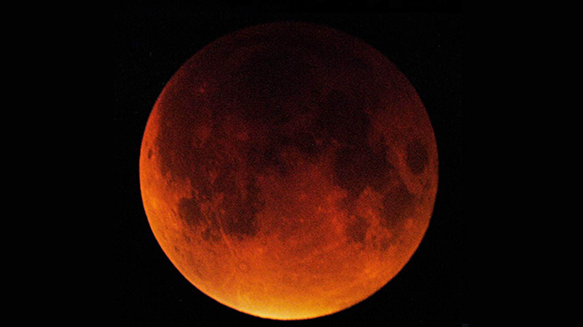 The full moon in total eclipse, Sept. 27, 2015. Photographed in Tucson, Arizona, by Steward Observatory astronomer Glenn Schneider.