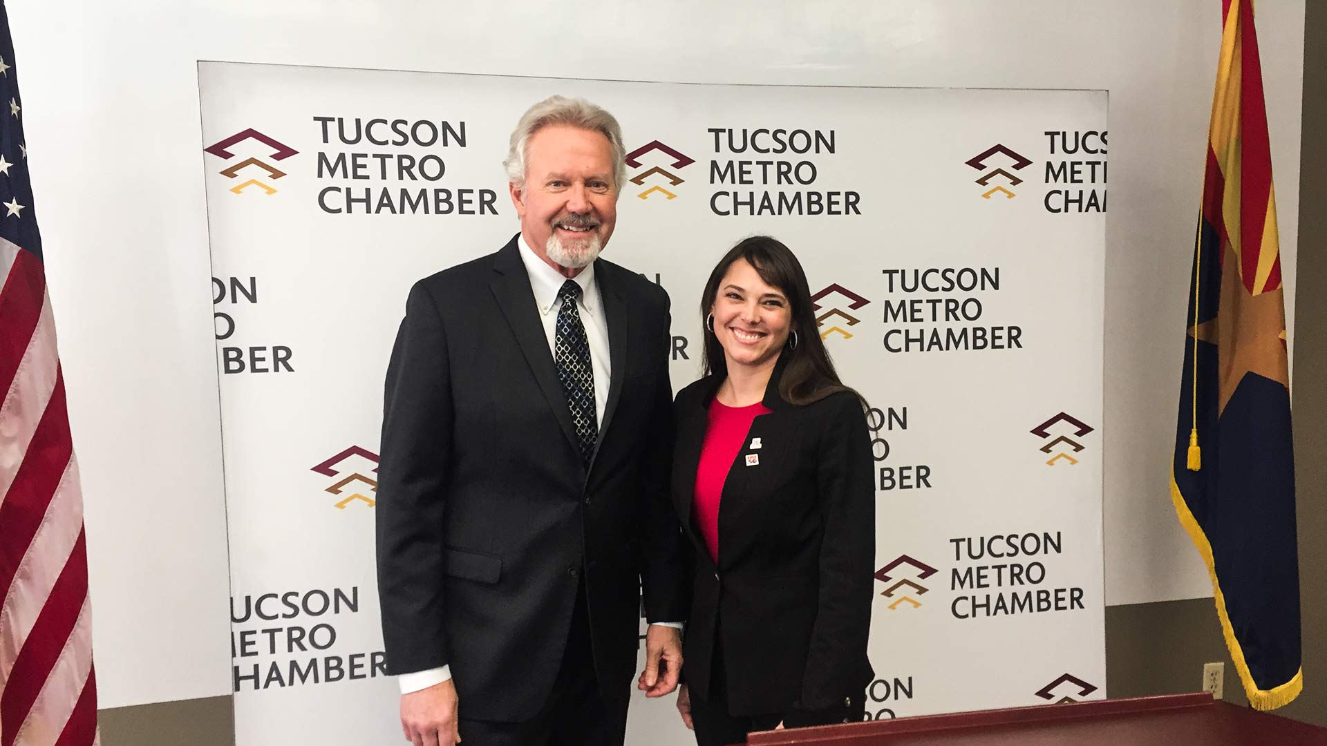 Amber Smith, right, takes over from Mike Varney, left, as president and CEO of the Tucson Metro Chamber of Commerce.