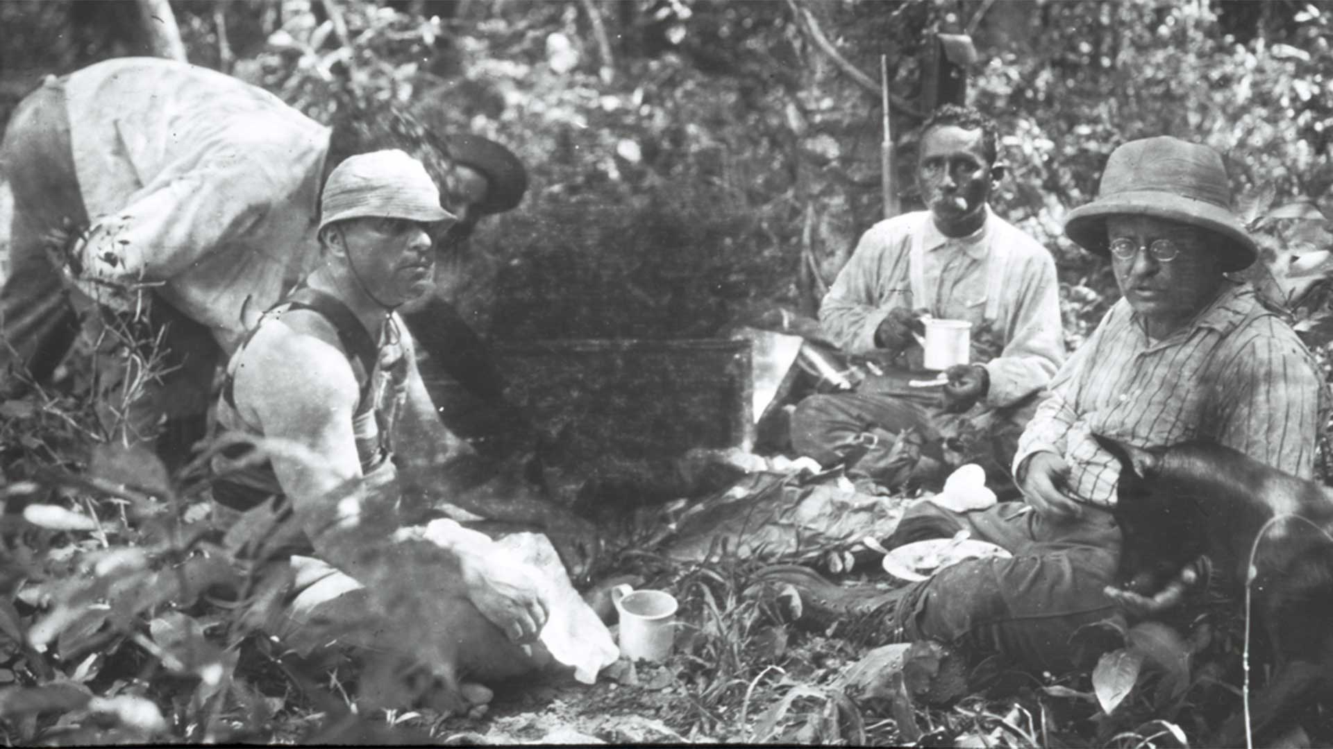 Theodore Roosevelt, Candido Rondon and camaradas sitting in camp, 1914.