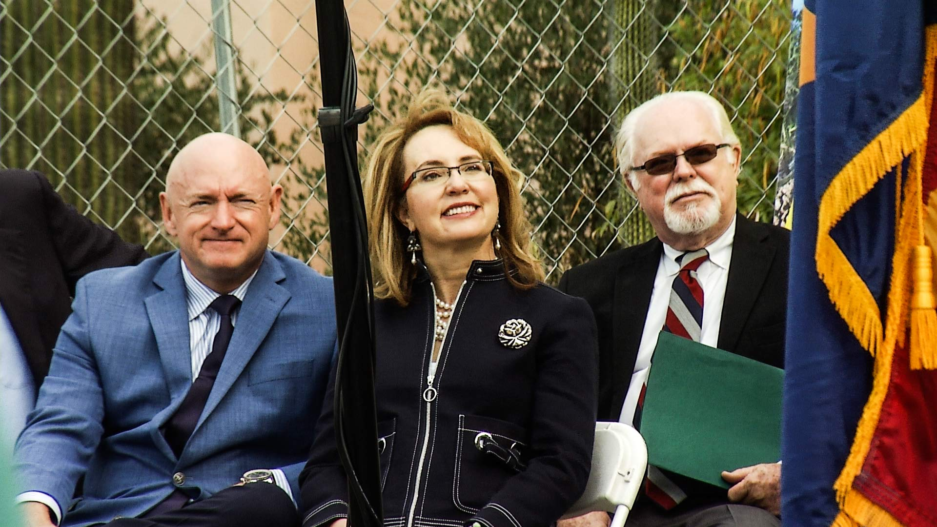 Mark Kelly, Gabrielle Giffords and Ron Barber at a memorial for the 2011 mass shooting in Tucson, Jan. 8, 2018.