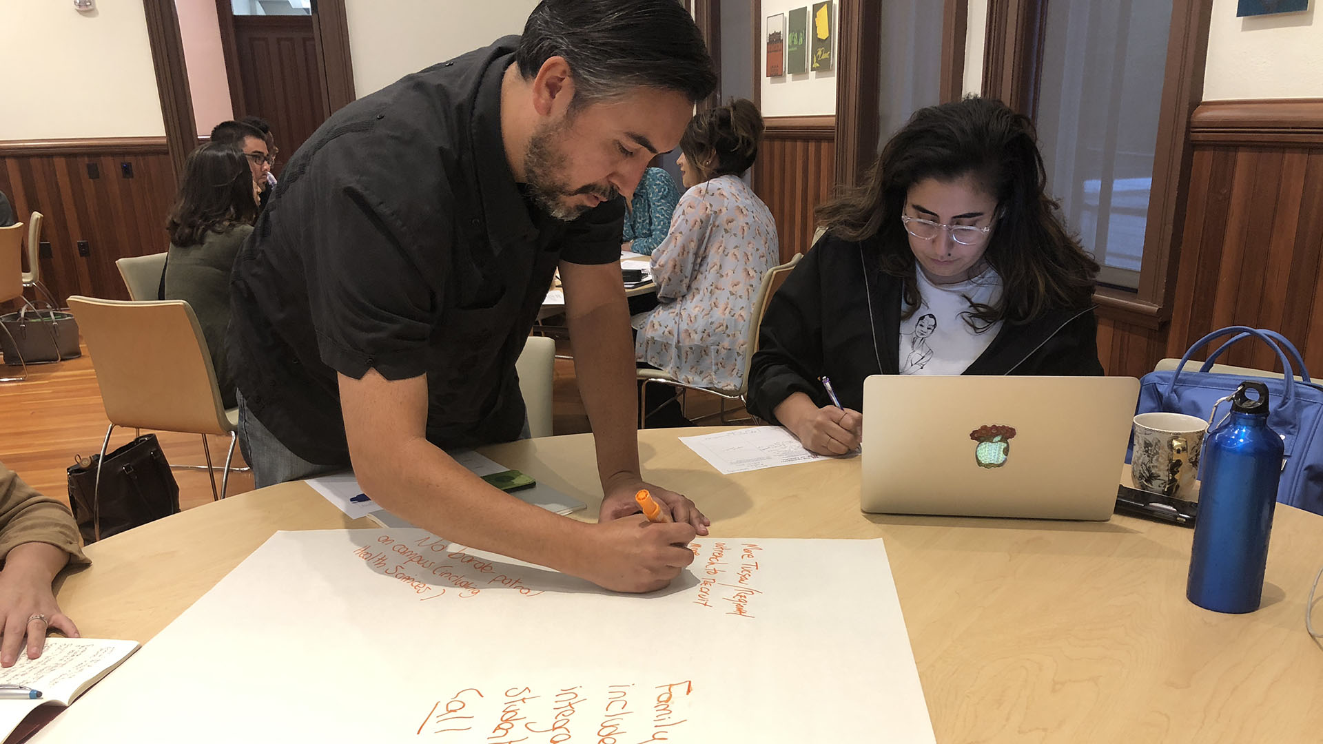 UA faculty member, Charlie Tousell (left), and Mexican American Studies Phd Student, Erika Nacim (right), sketch out their vision for the University of Arizona's Hispanic Serving Institution designation.