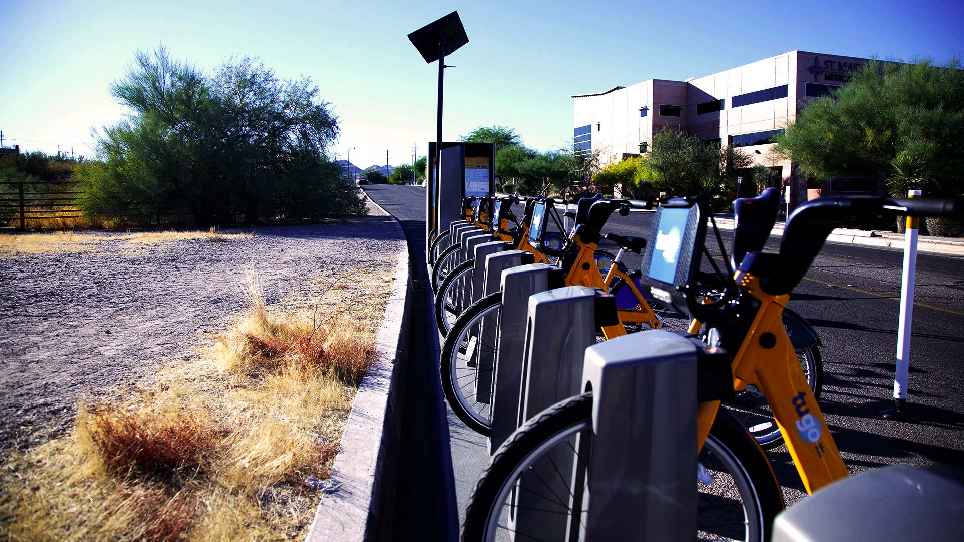 Bicycles for the Tugo city bike-share program near Tumamoc Hill on Tucson's west side, 2017.