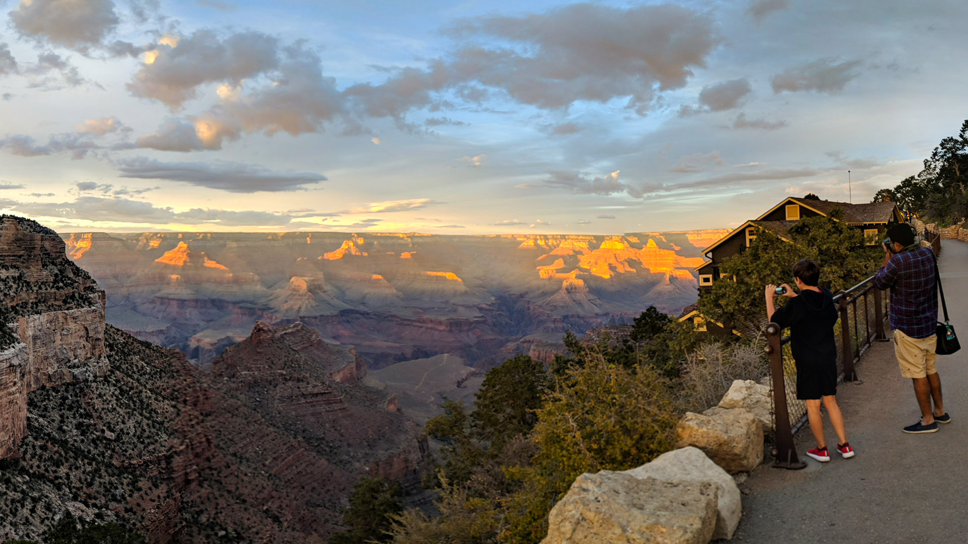 Visitors to the Grand Canyon's South Rim snap photos as the sun goes down, September 2018.