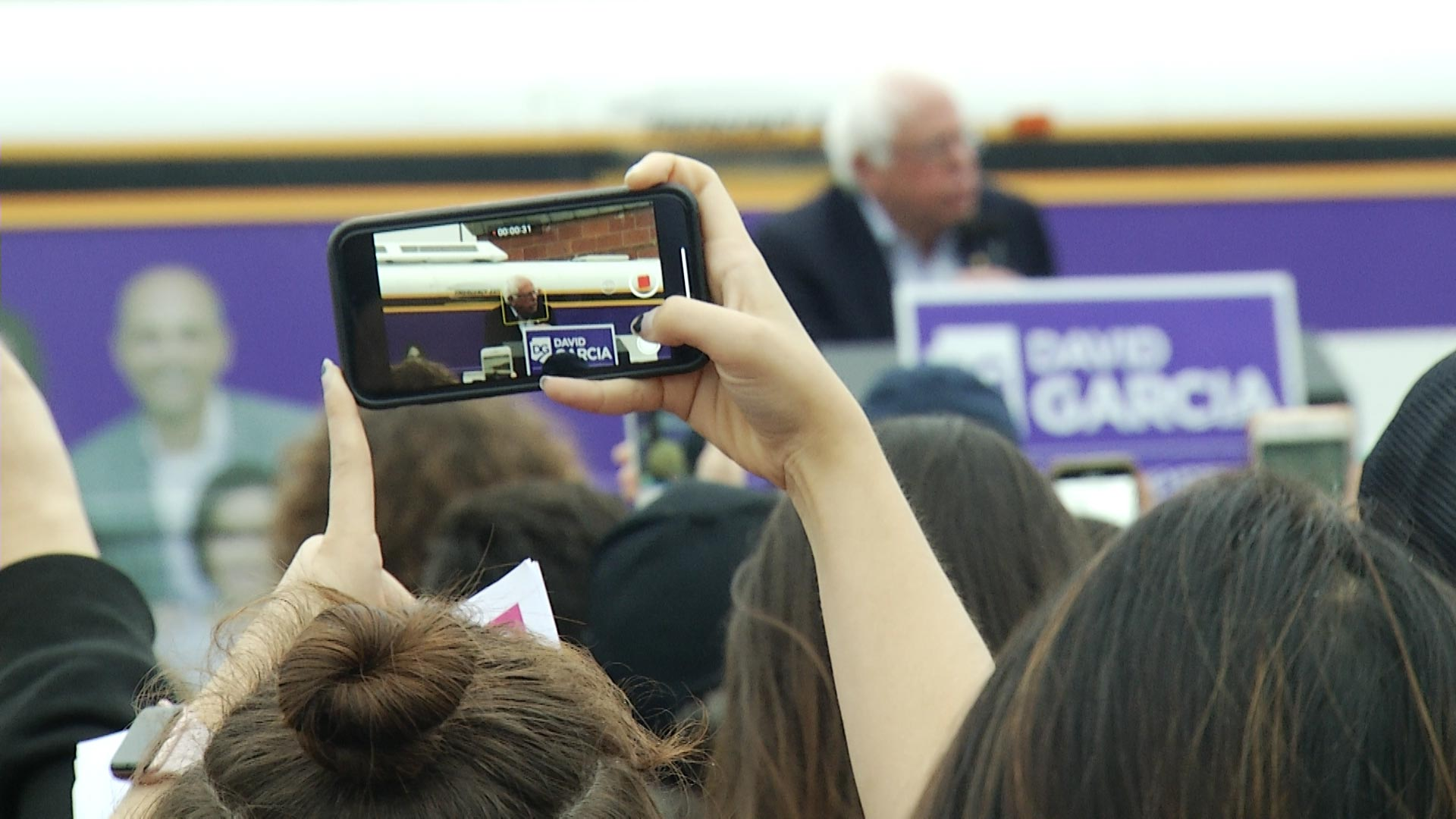A spectator uses a smartphone to record Vermont Sen. Bernie Sanders at a political rally at the University of Arizona on Tuesday, October 23, 2018.