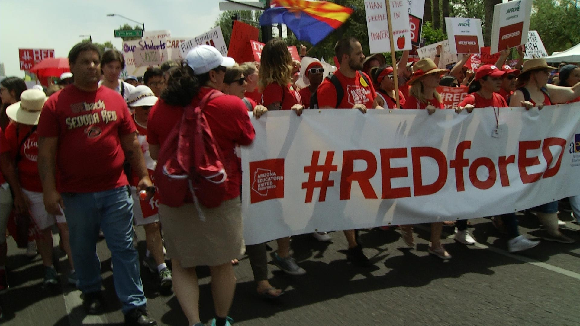 Red for Ed supporters march to the Arizona Capitol in Phoenix.