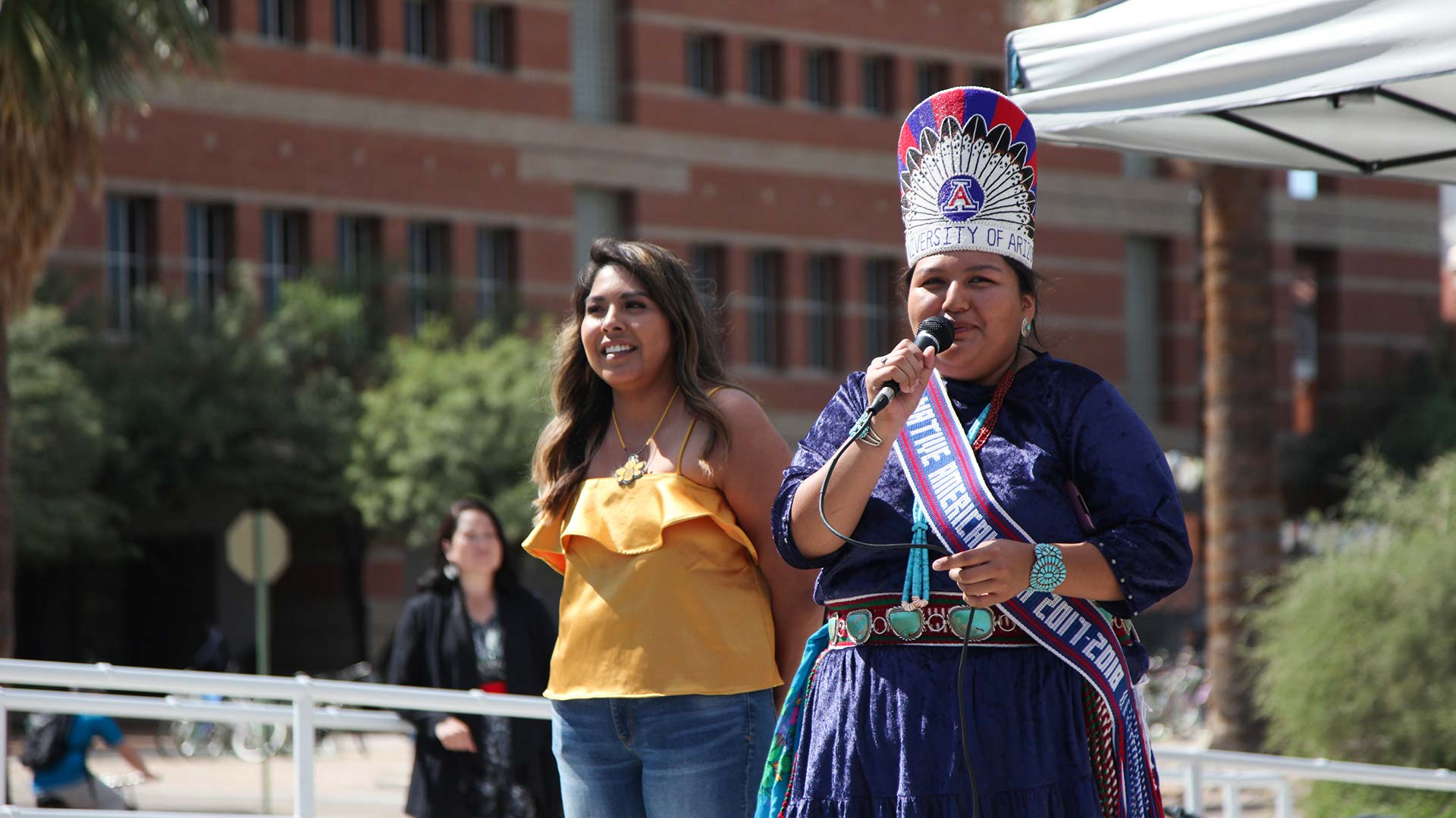 Miss Native American University of Arizona, right, speaks at an event on campus for Indigenous Peoples' Day, Oct. 8, 2018.