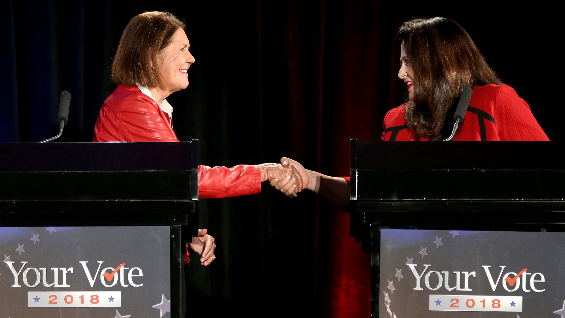Candidates for the 2nd Congressional District, Democrat Ann Kirkpatrick, left, and Republican Lea Marquez Peterson, shake hands following a televised debate at the Tucson Jewish Community Center, Tuesday, Oct. 9, 2018, Tucson, Arizona.