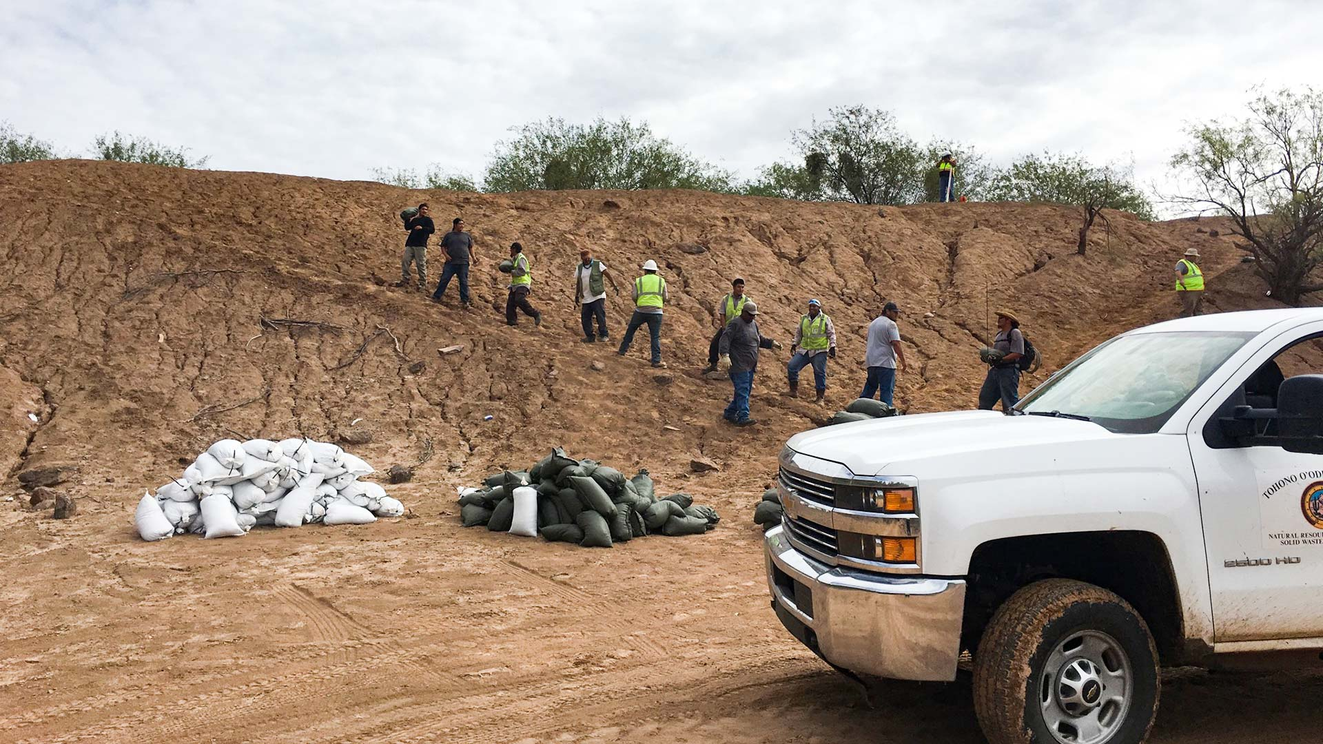 More than 80 volunteers helped fill and place sandbags at Menagers Dam.