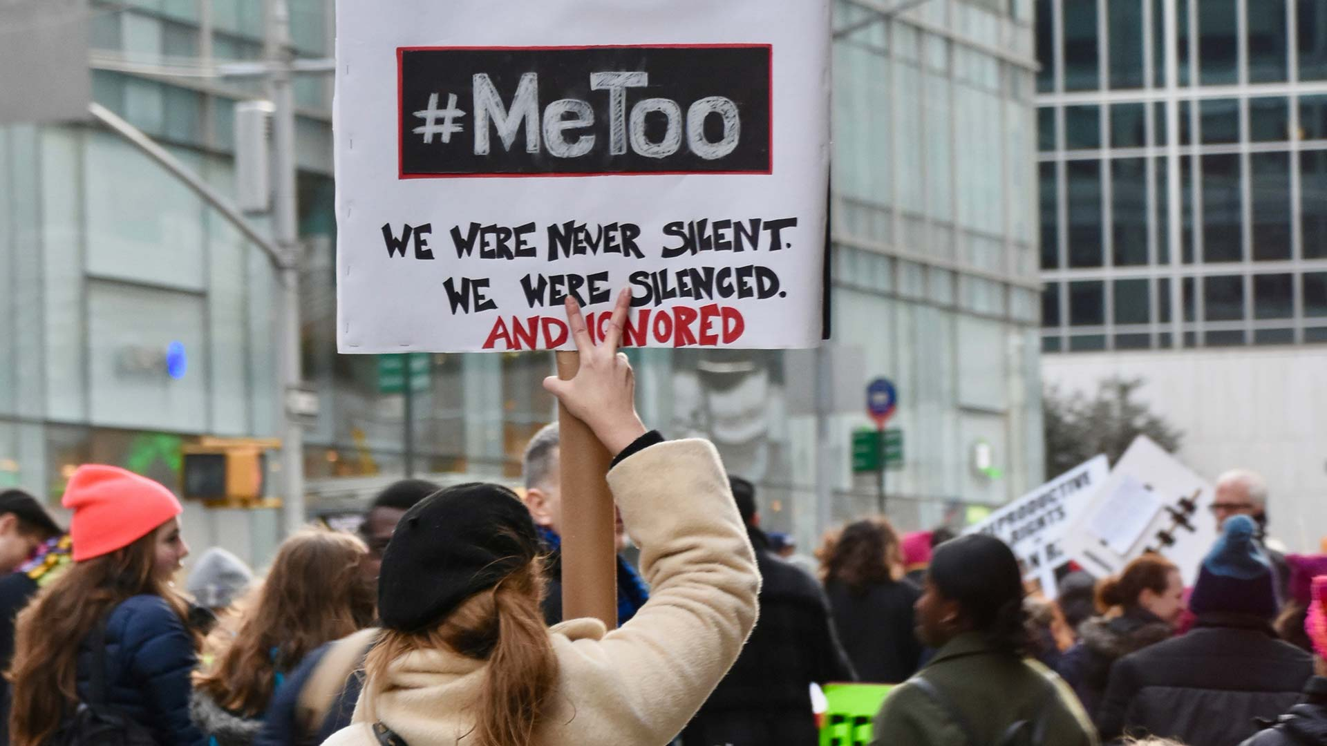 A protester holds a #MeToo sign at a march.