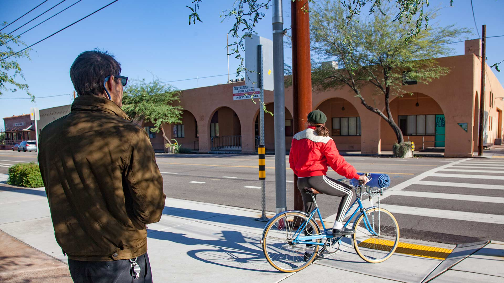 An employee of the Pima Association of Governments makes a note of non-motorized travel for the annual bike and pedestrian count.