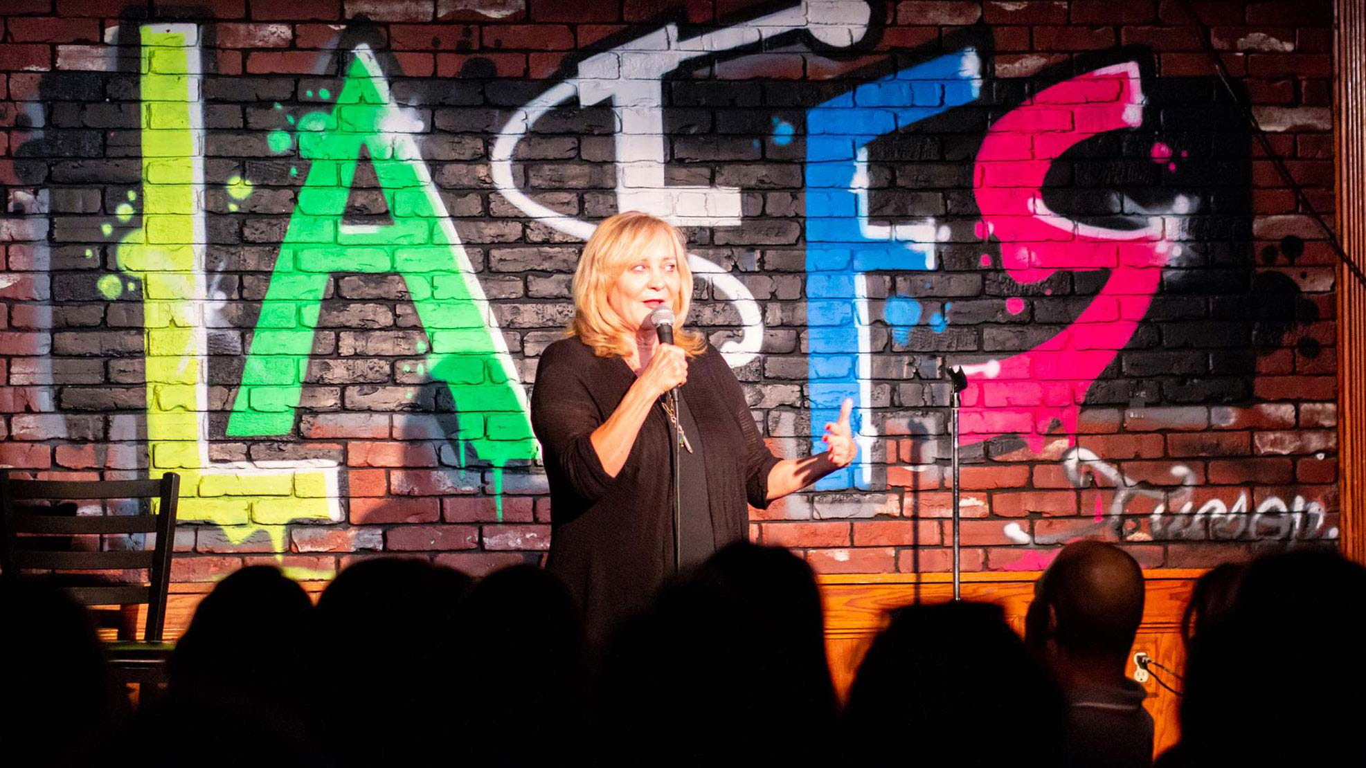 "Nancy Stanley and other comedians perform during ""The Estrogen Hour"" at Laffs Comedy Caffé in Tucson."