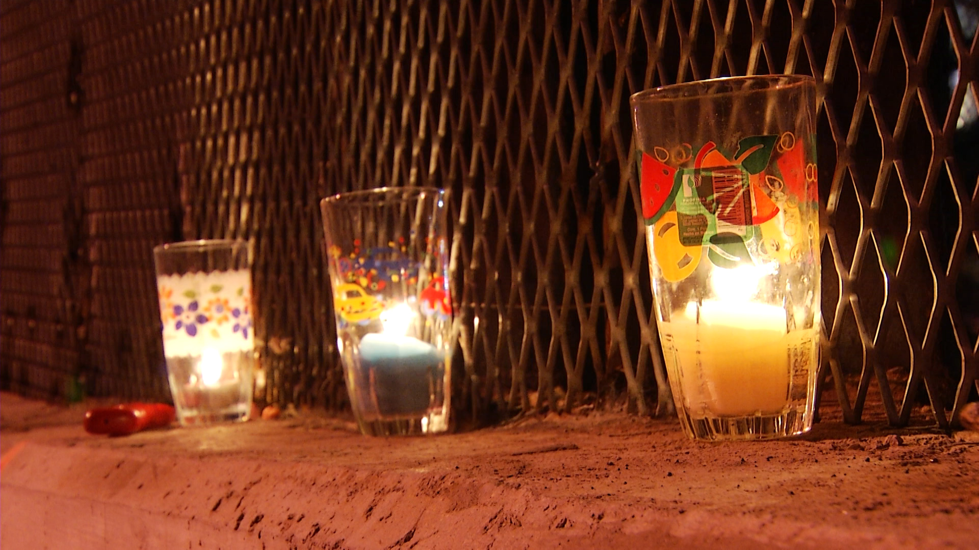 Candles lit for a vigil burn along the U.S.-Mexico border in Nogales, Arizona.