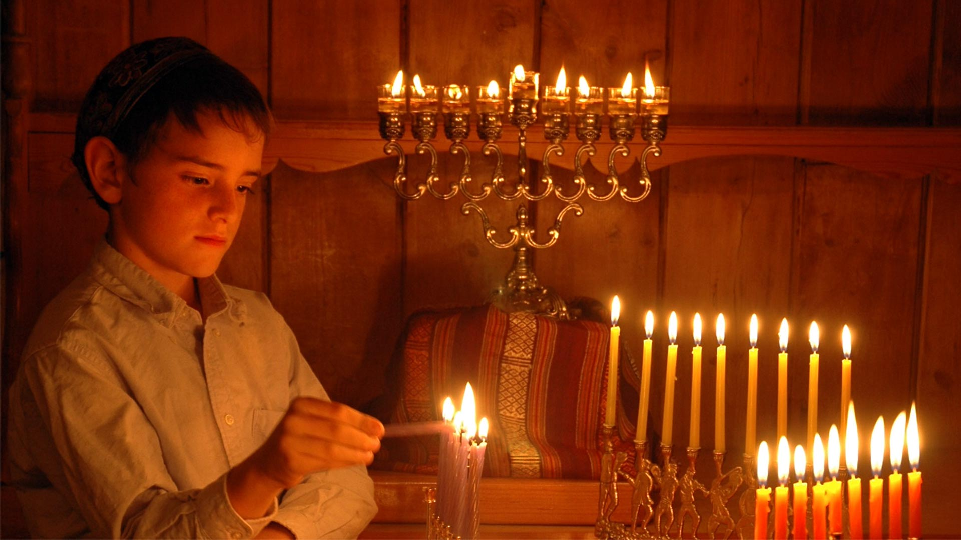 HANUKKAH: A FESTIVAL OF DELIGHTS examines the traditions at the center of the Jewish holiday of Hanukkah, including lighting candles for eight nights on the lamp known as a menorah.
